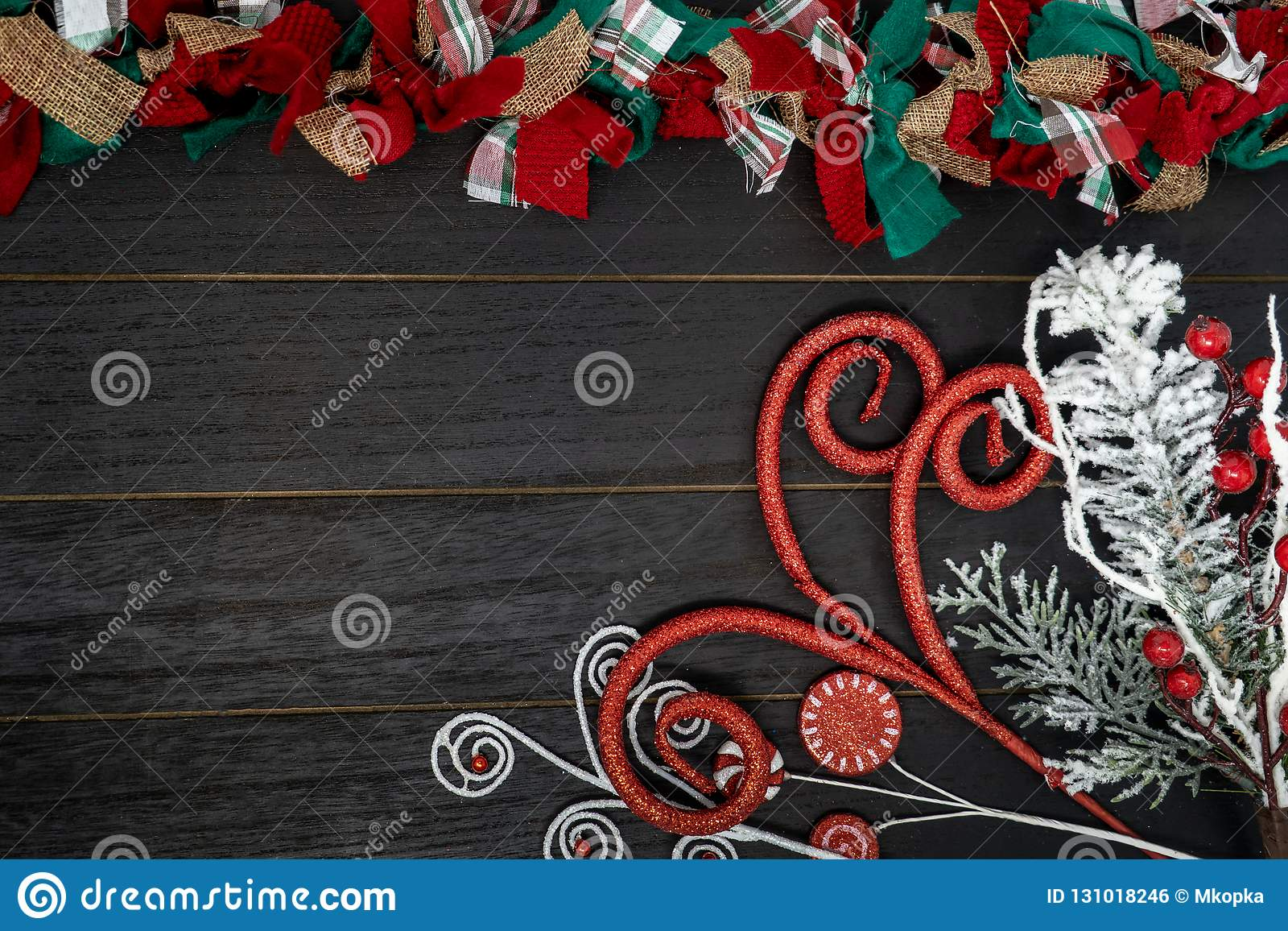 Festive Christmas Red Green And White Rag Fabric Garland Over Black Wood Backgro Stock Photo Image Of Merry Backdrop 131018246