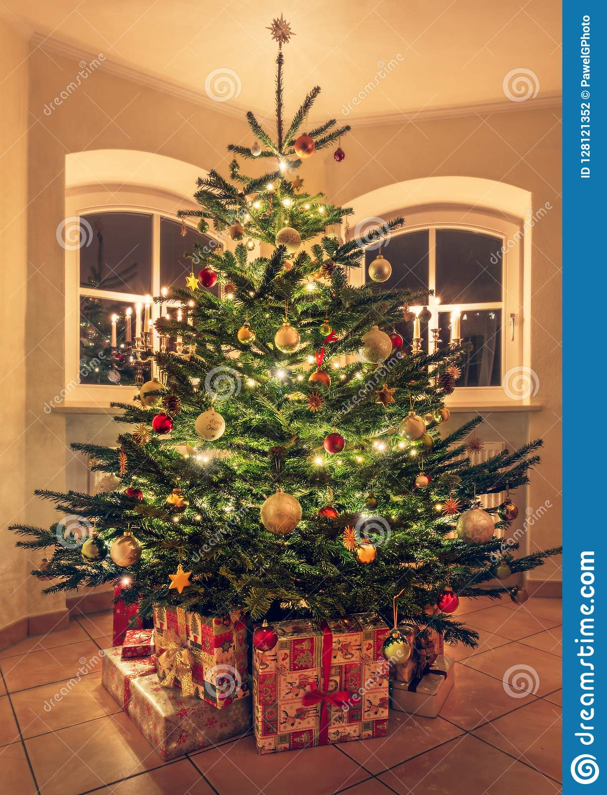 Festive Christmas Tree With Garland Lights Gifts And Decoration Stock Photo Image Of Design Candlelight 128121352
