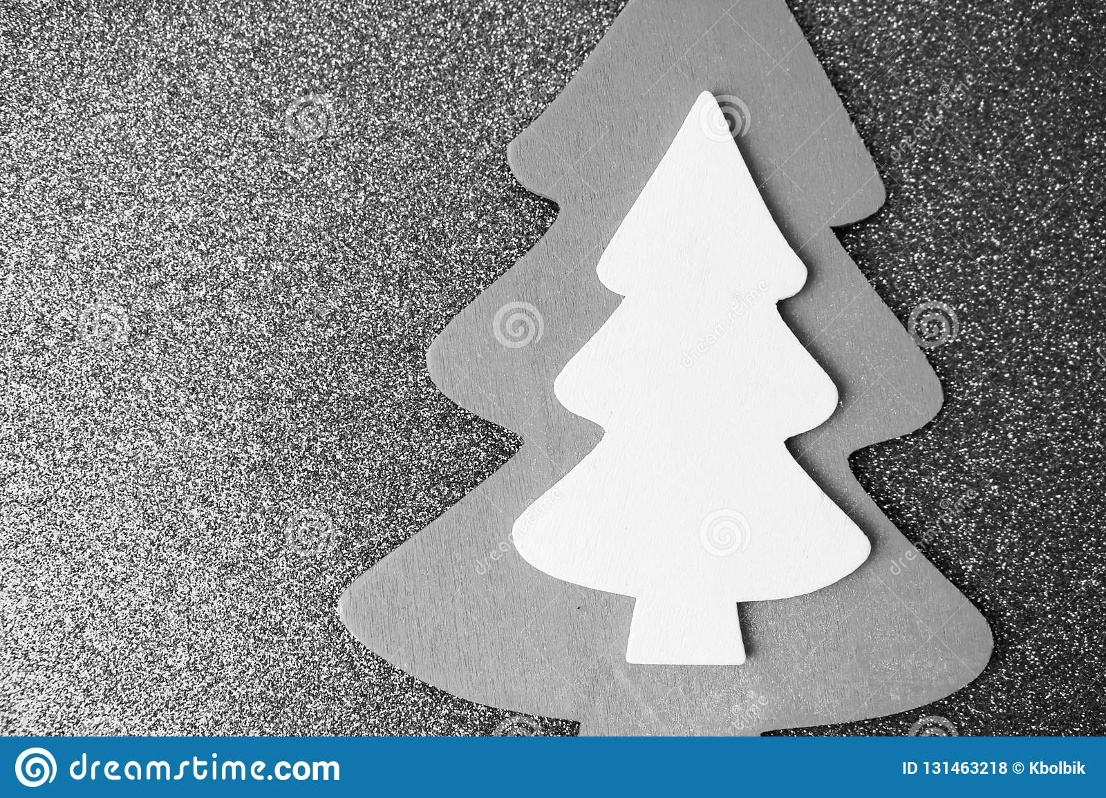 Festive Christmas Christmas winter happy beautiful black and white background with a small toy wooden homemade cute Christmas tree