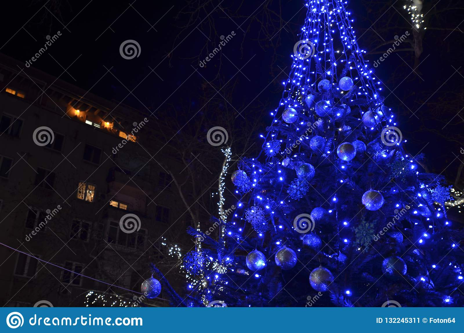Festive Decorated Christmas Tree With Blue Led Lights Stock