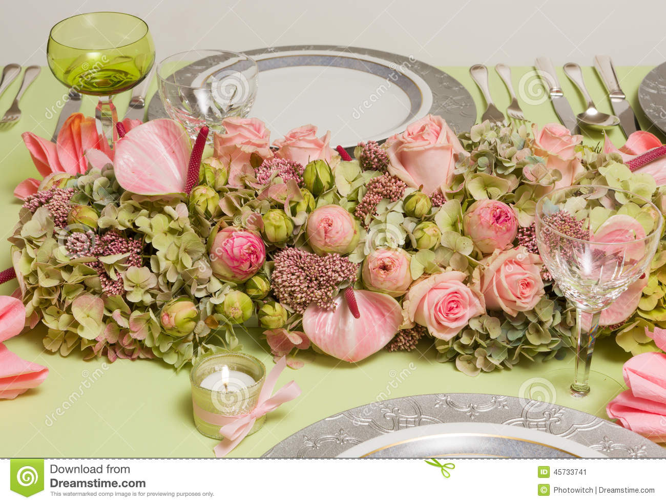 Festive flower arrangement on dinner table stock image for Dinner table flower arrangements