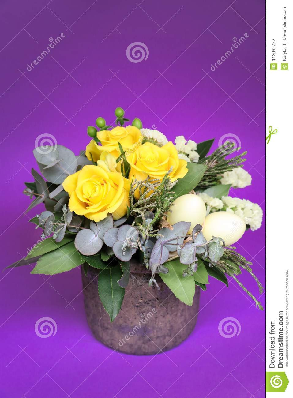 Festive Flower Arrangement Of Yellow Roses And Other Plants With Easter Eggs Decorated On Violet Background Stock Photo Image Of Floral Holiday 113092722