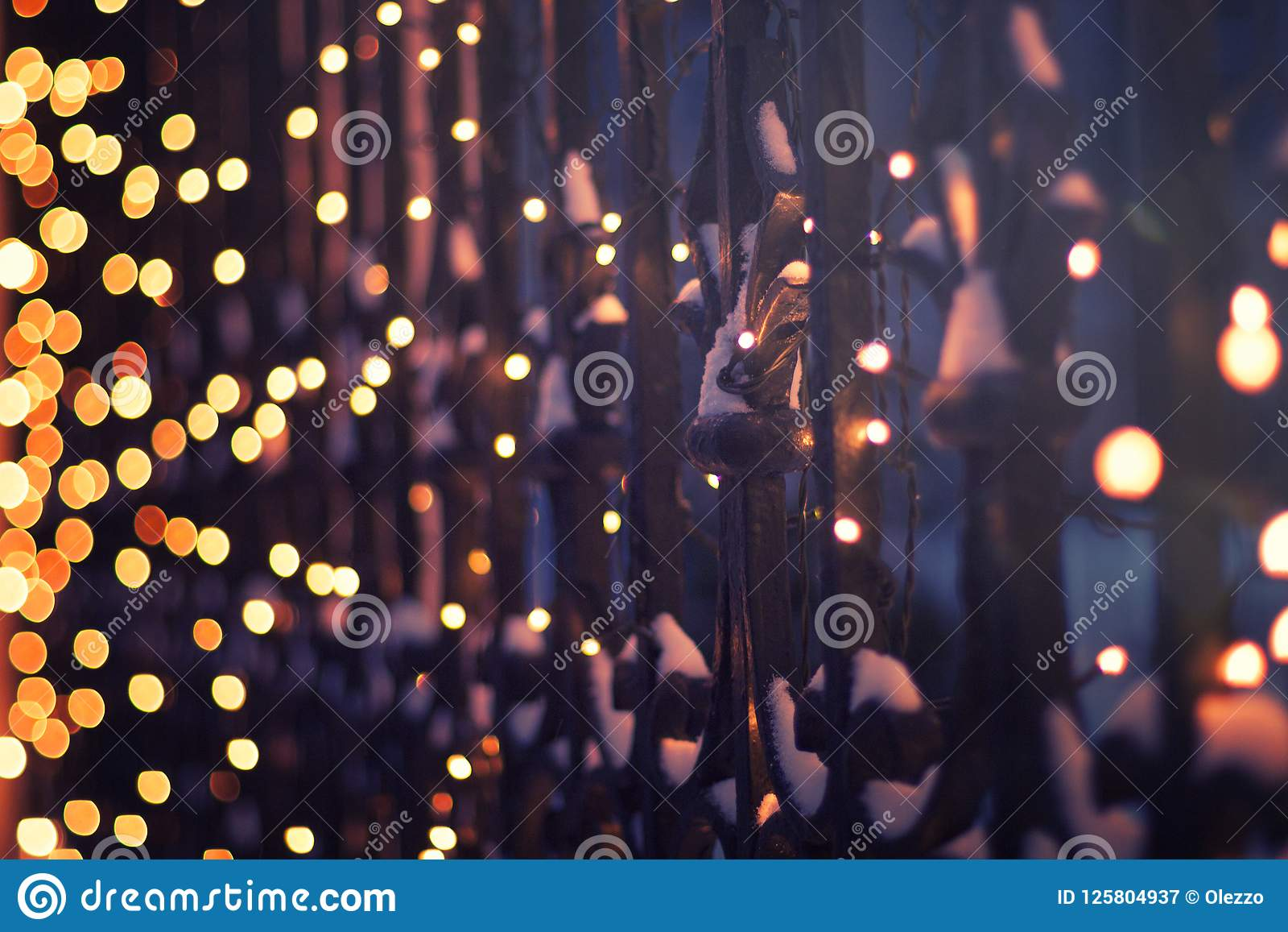 Festive illumination on the fence in the evening winter time, ab
