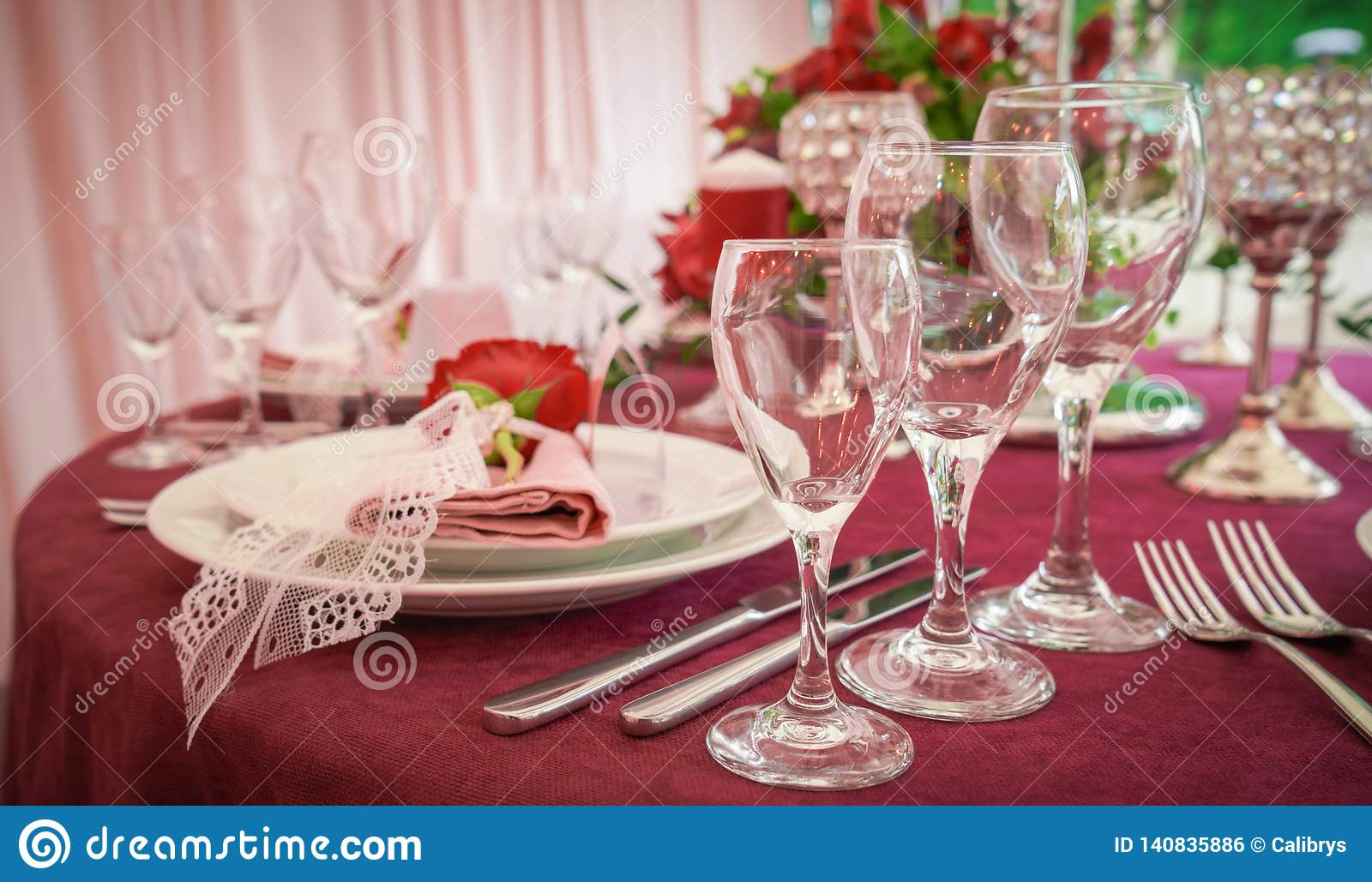 Festive table decoration with red flowers
