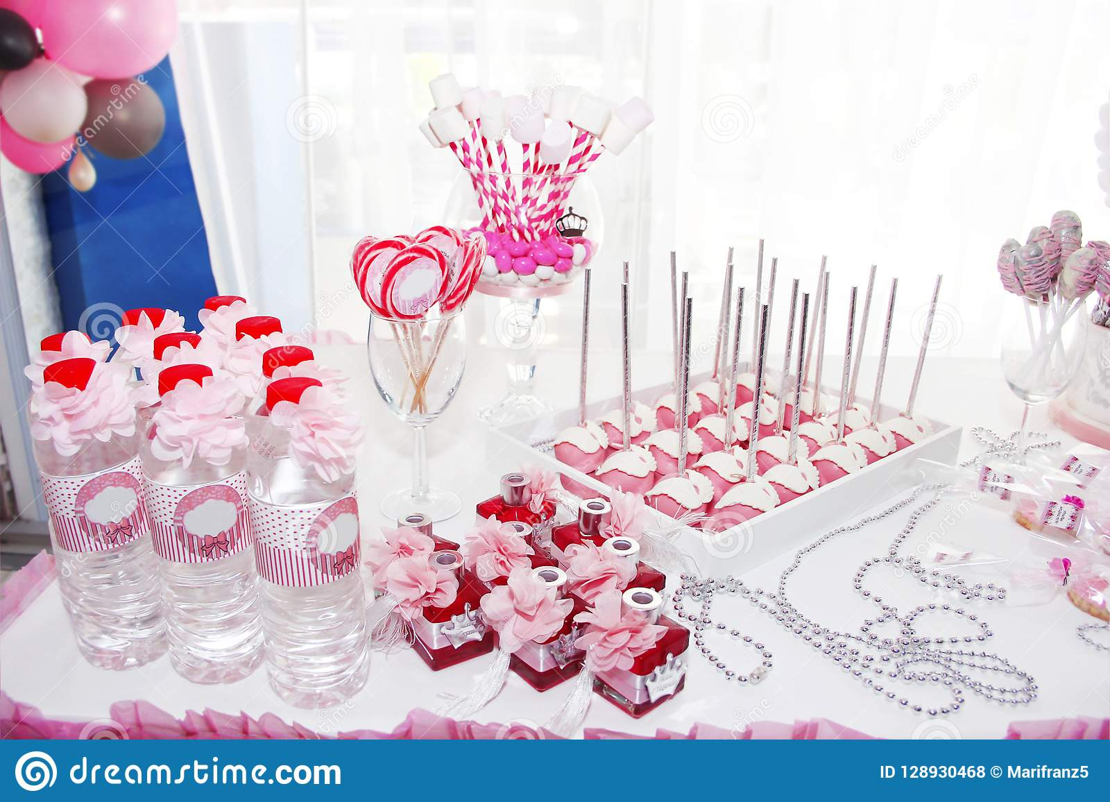 Festive Table Decorations With Cake Cupcakes Sweets And Gifts In Pink Color