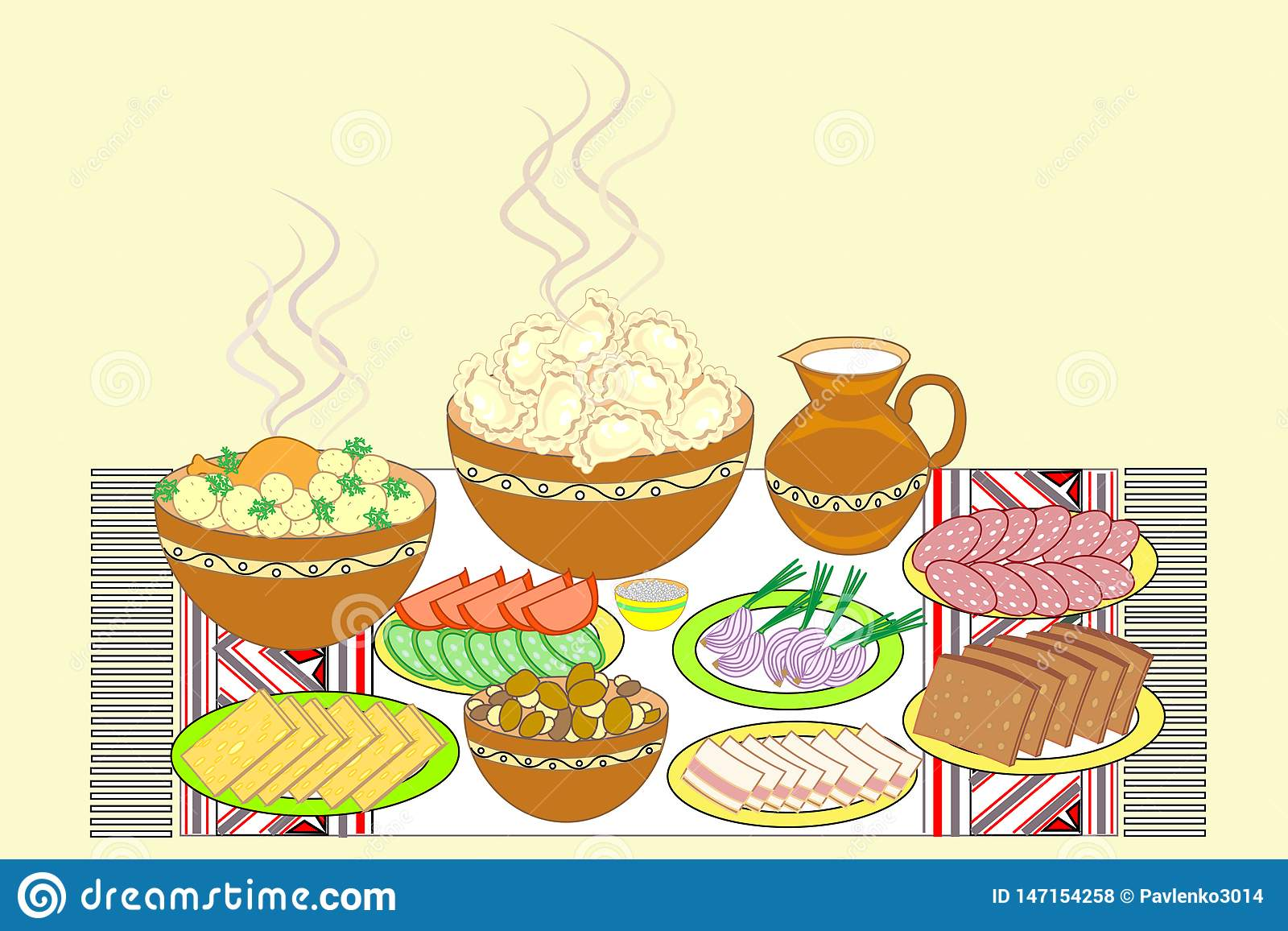 Festive table set. Ukrainian national dishes dumplings, bread, lard, meat, vegetables. Tasty dishes are placed on an embroidered