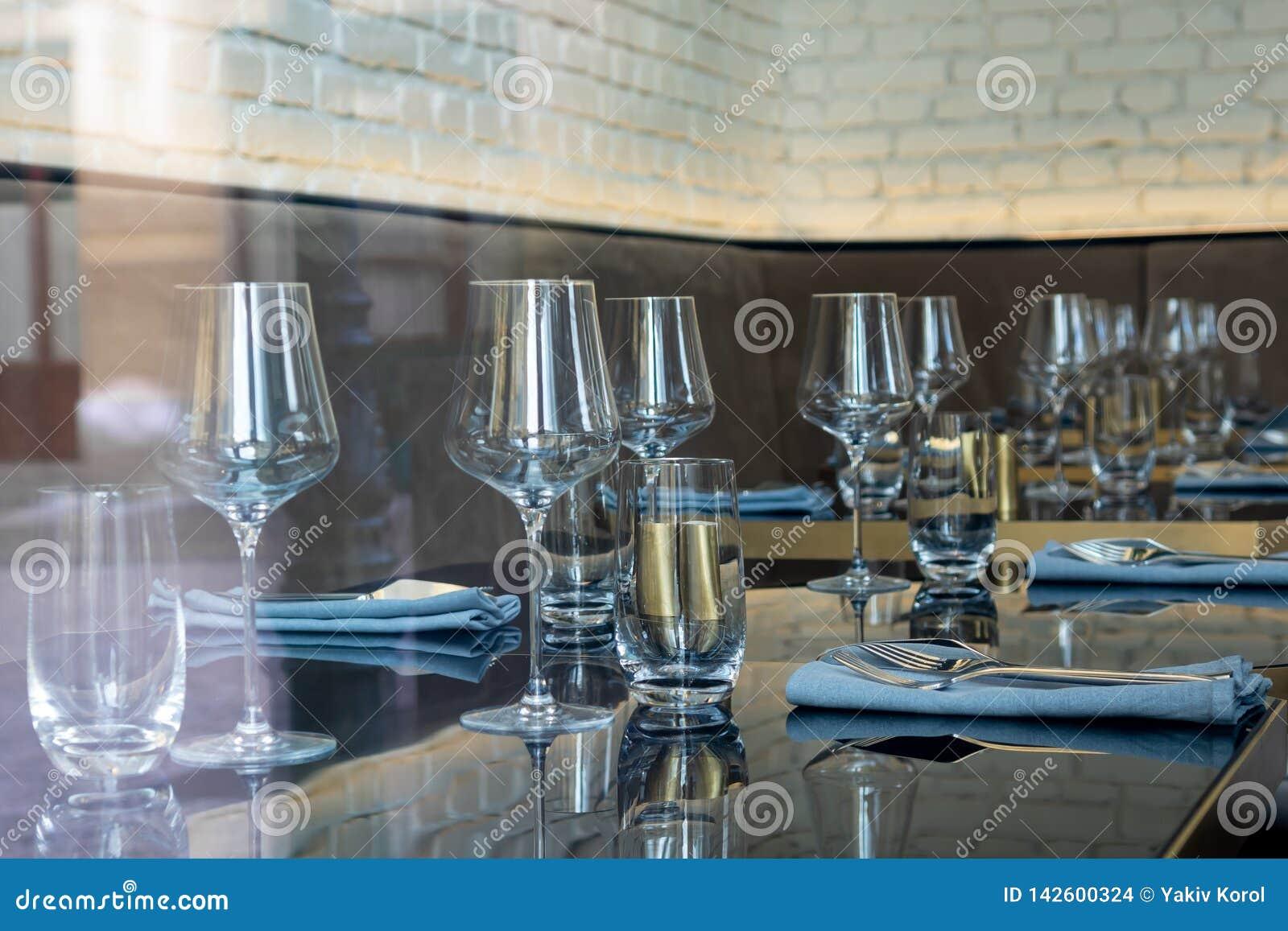 Festive table setting. Empty glasses, cutlery