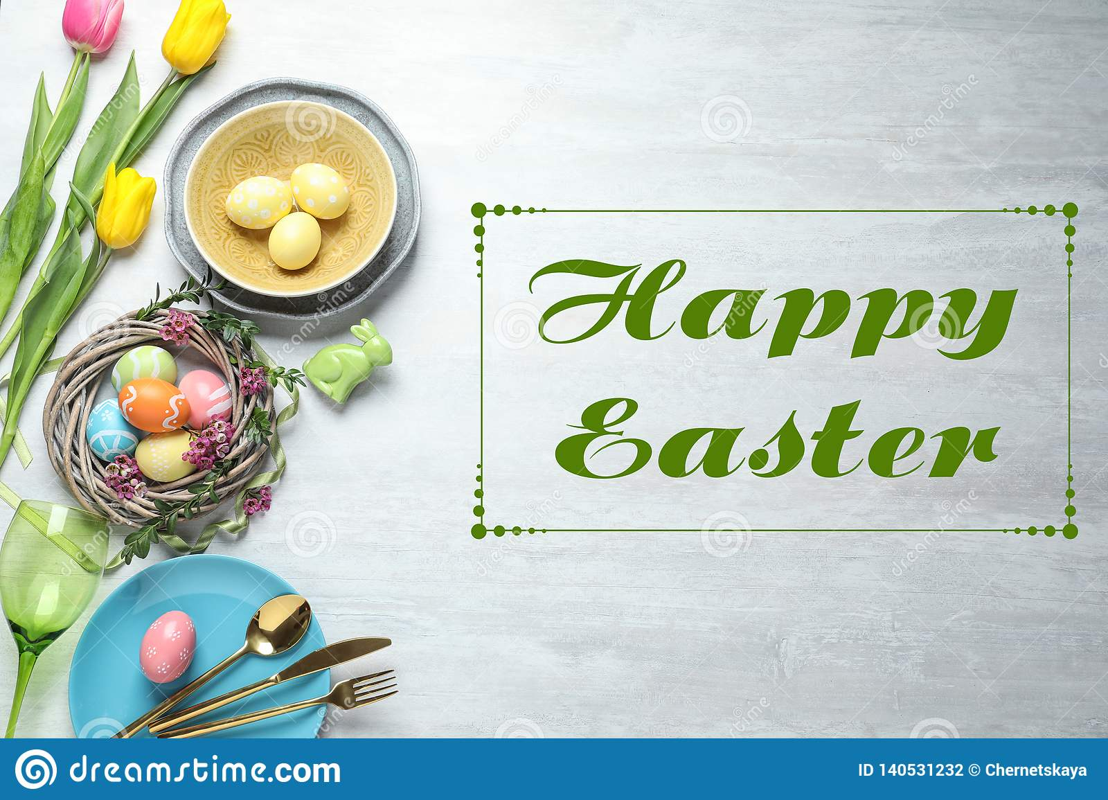 Festive table setting and text Happy Easter on wooden background