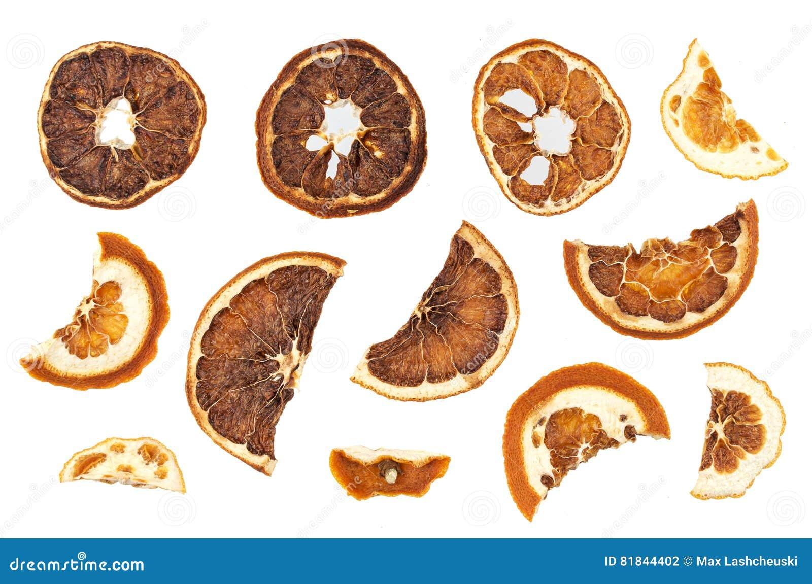 Fette secche delle arance isolate su fondo bianco - Arance secche decorazione ...