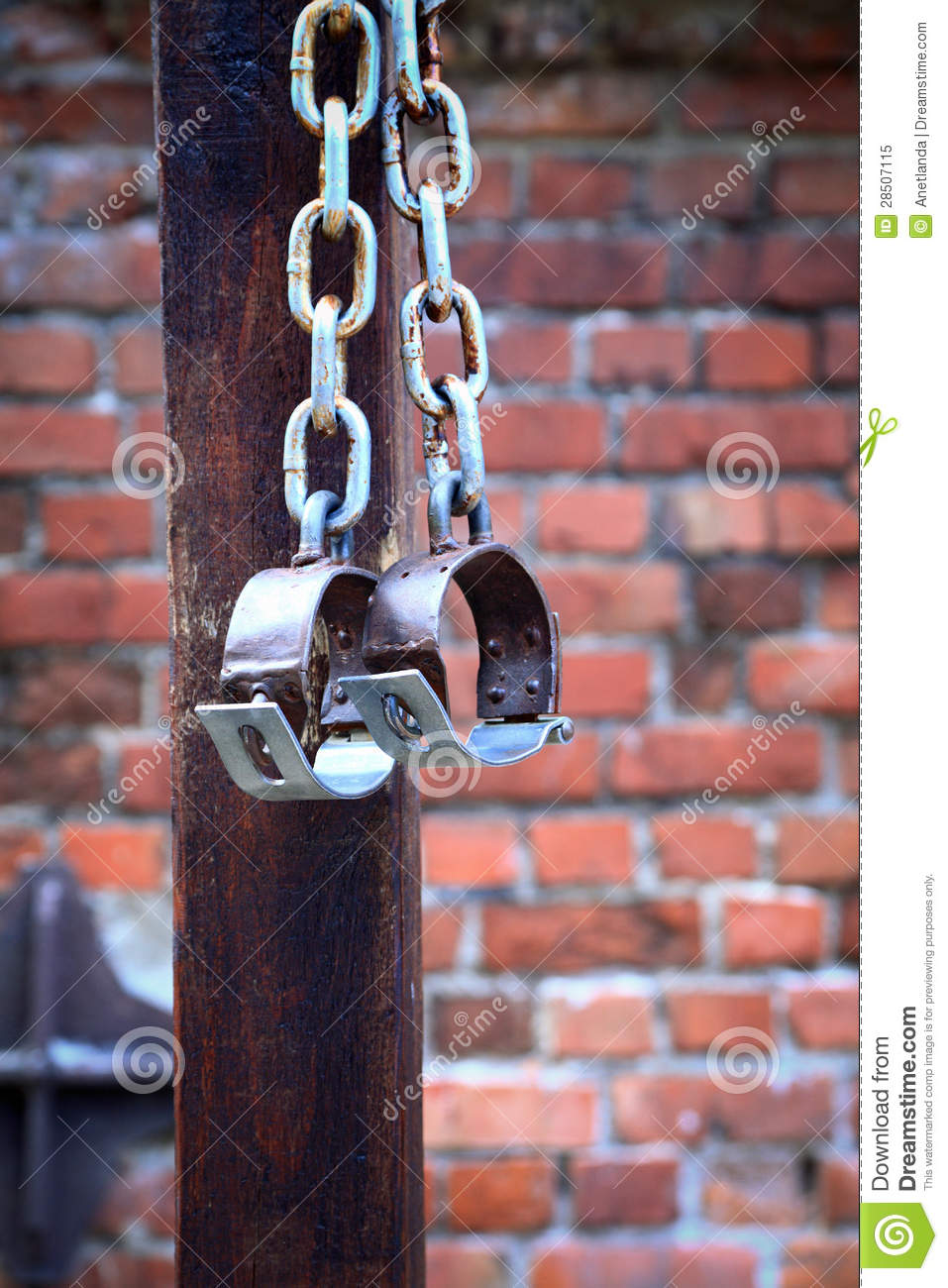 Fetters Manacles On Brick Background Royalty Free Stock