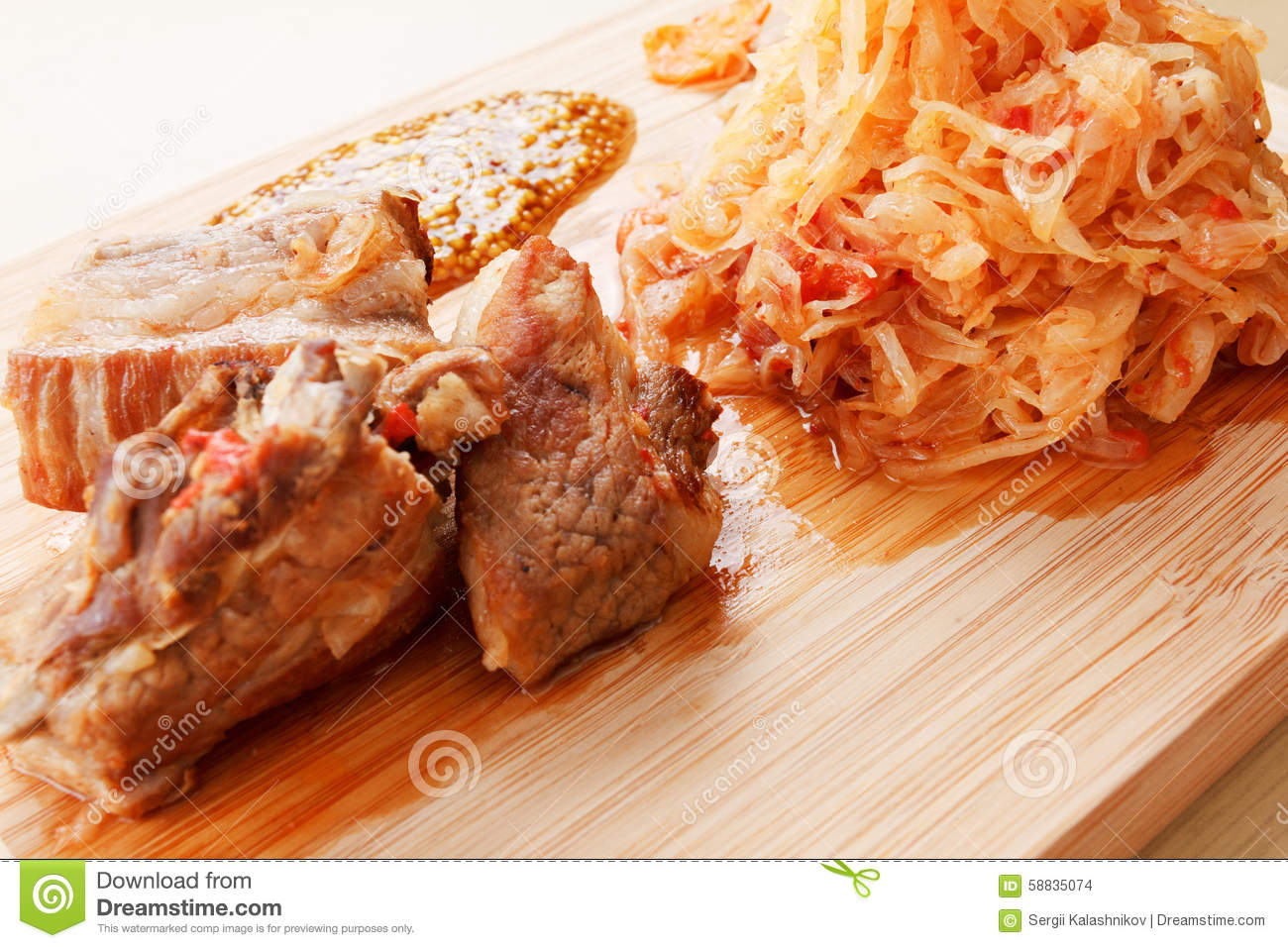 Few Roasted Pork Ribs With Tomato, Carrots And Cabbage On ...