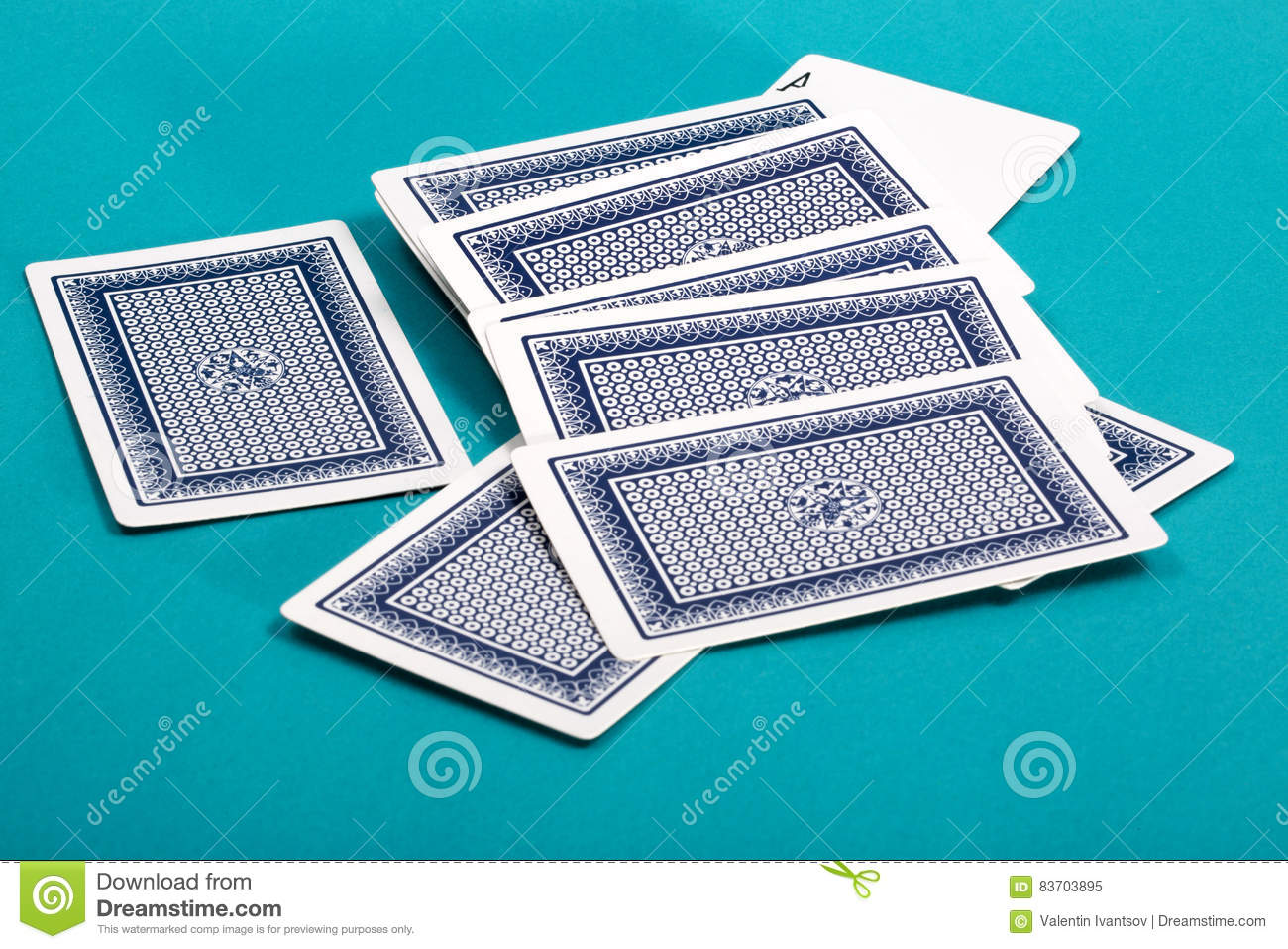 A Few Scattered Playing Cards On A Green Stock Photo