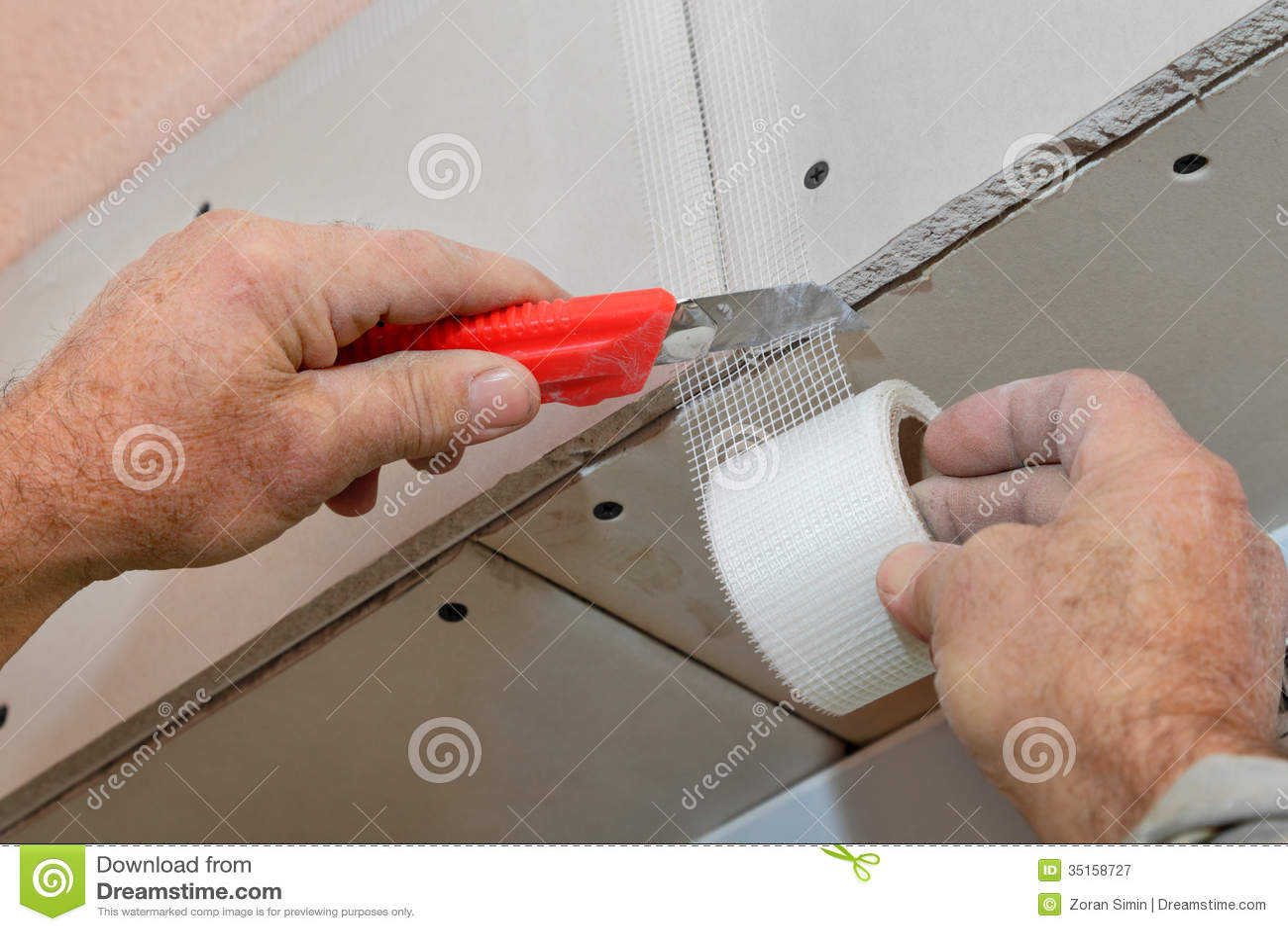 Gypsum Board Installation : Fiber mesh cut stock image of renovating