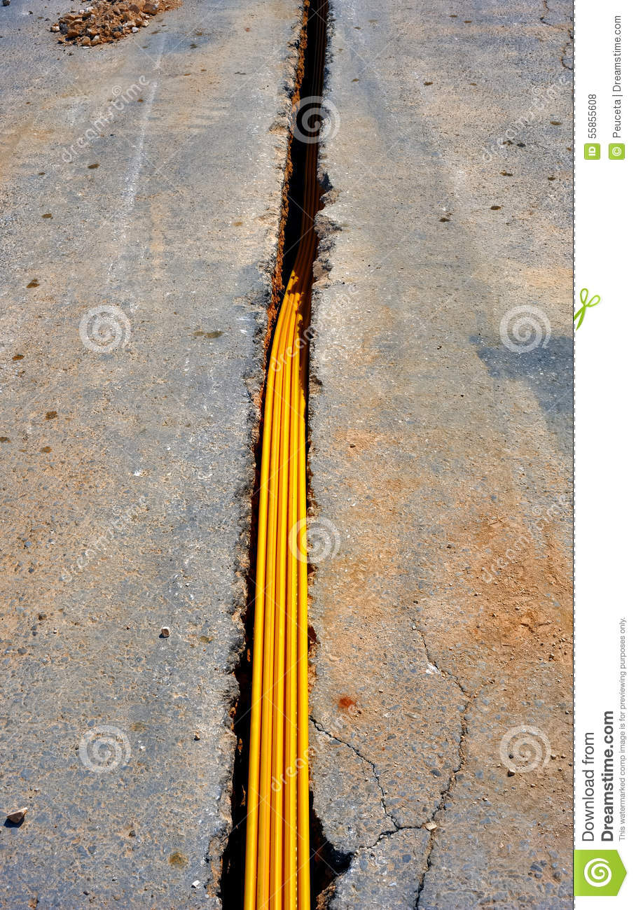 Bury Electrical Cable : Fiber optic cables buried in a micro trench stock photo