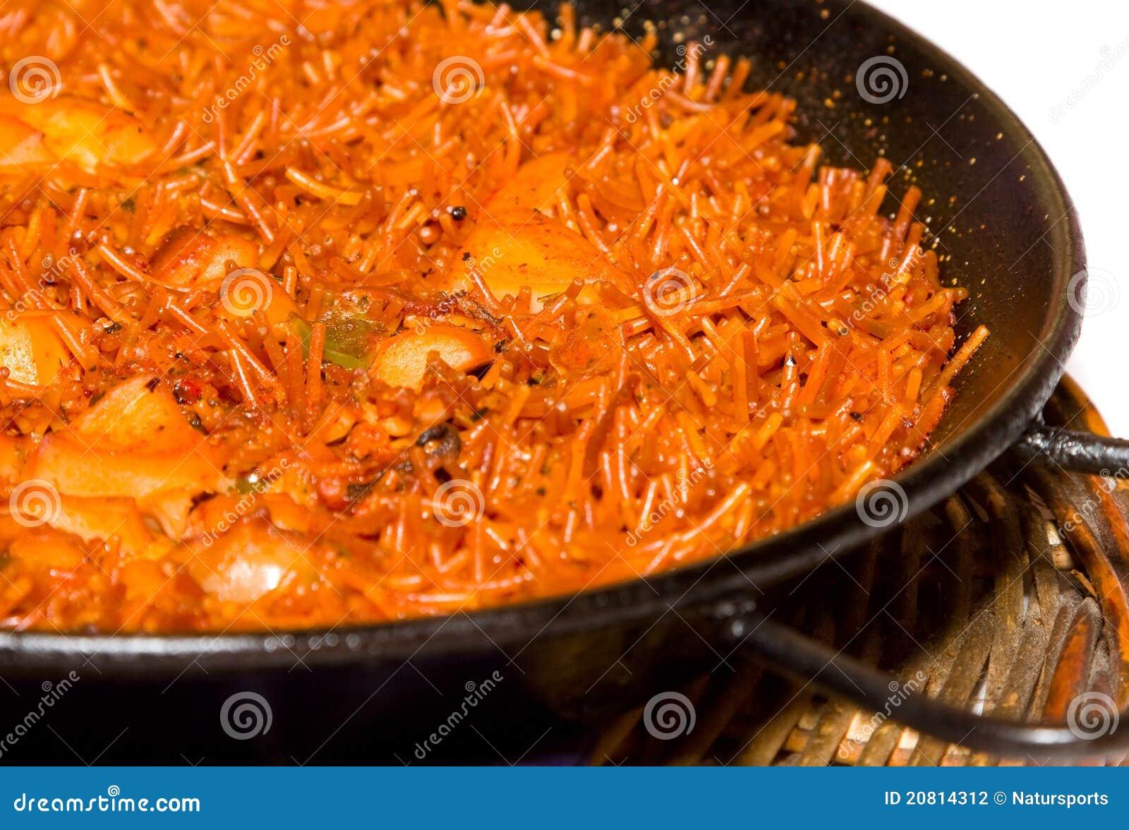 Fideua or spanish noodle paella.