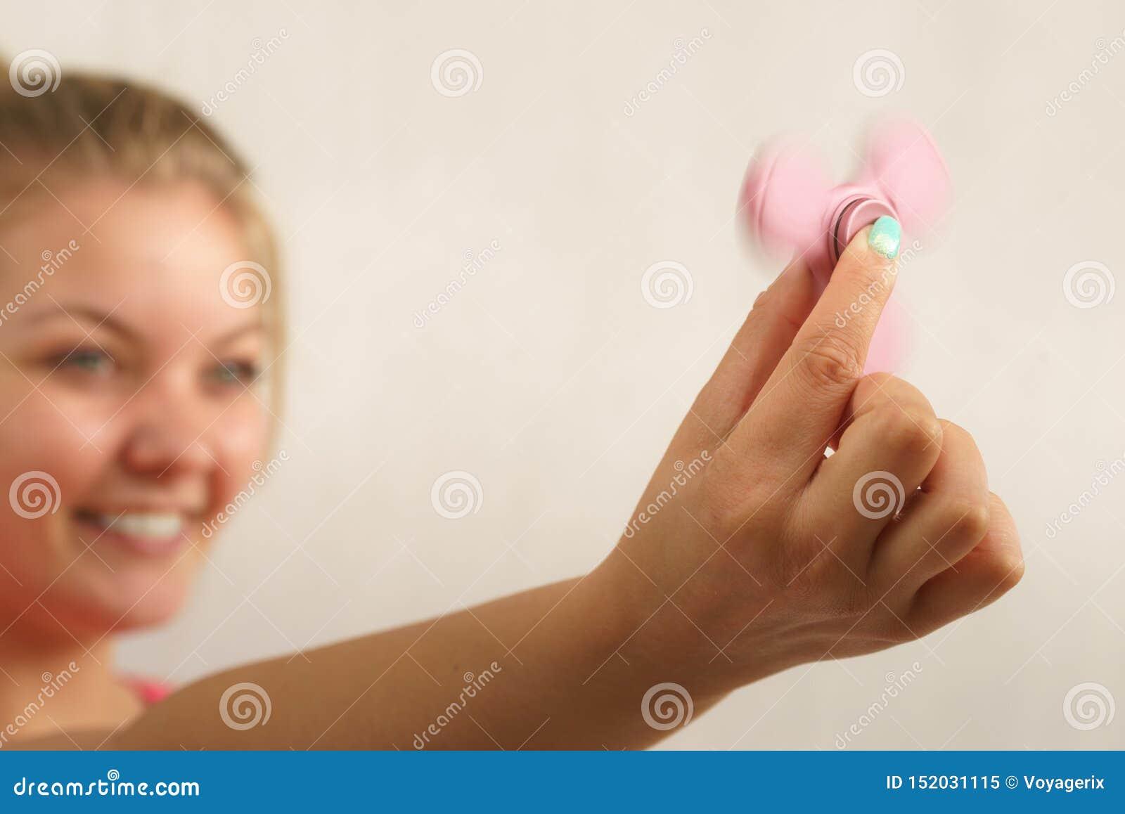 Fidget spinner rotating in female hand