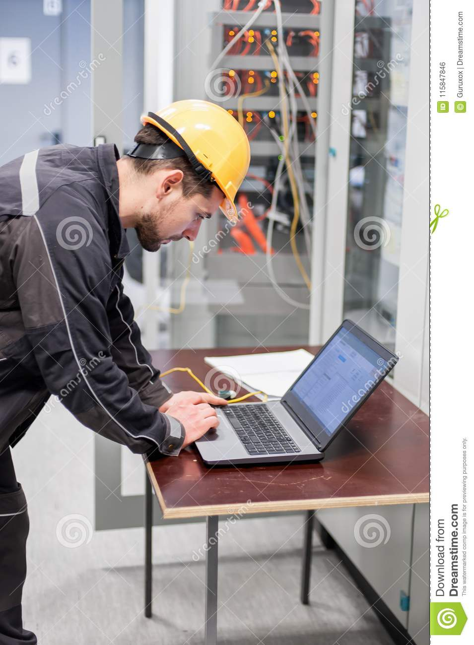 Field Service Engineer Inspect Relay Protection System With
