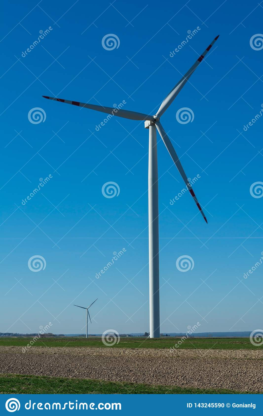 Field with windmills for electric power. Clean energy produced by the wind. Extraction of energy from the air