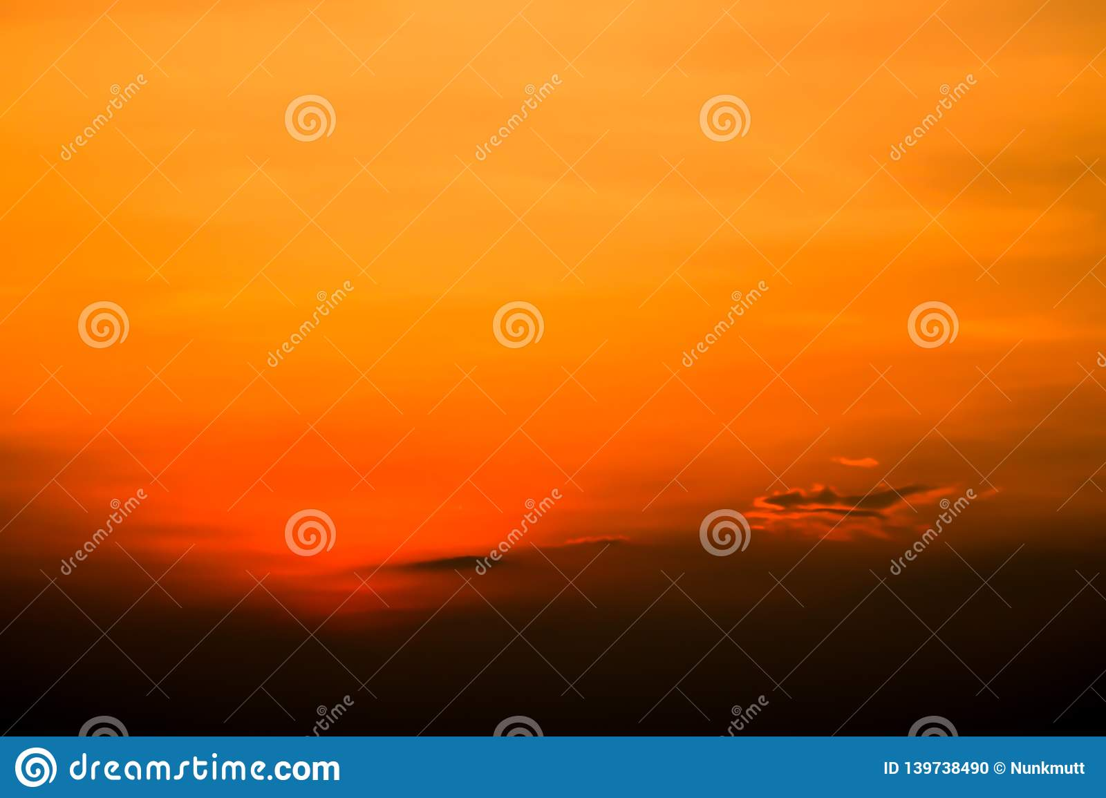 Fiery orange colorful sunset sky. Beautiful sky color of hope and happiness concept idea background