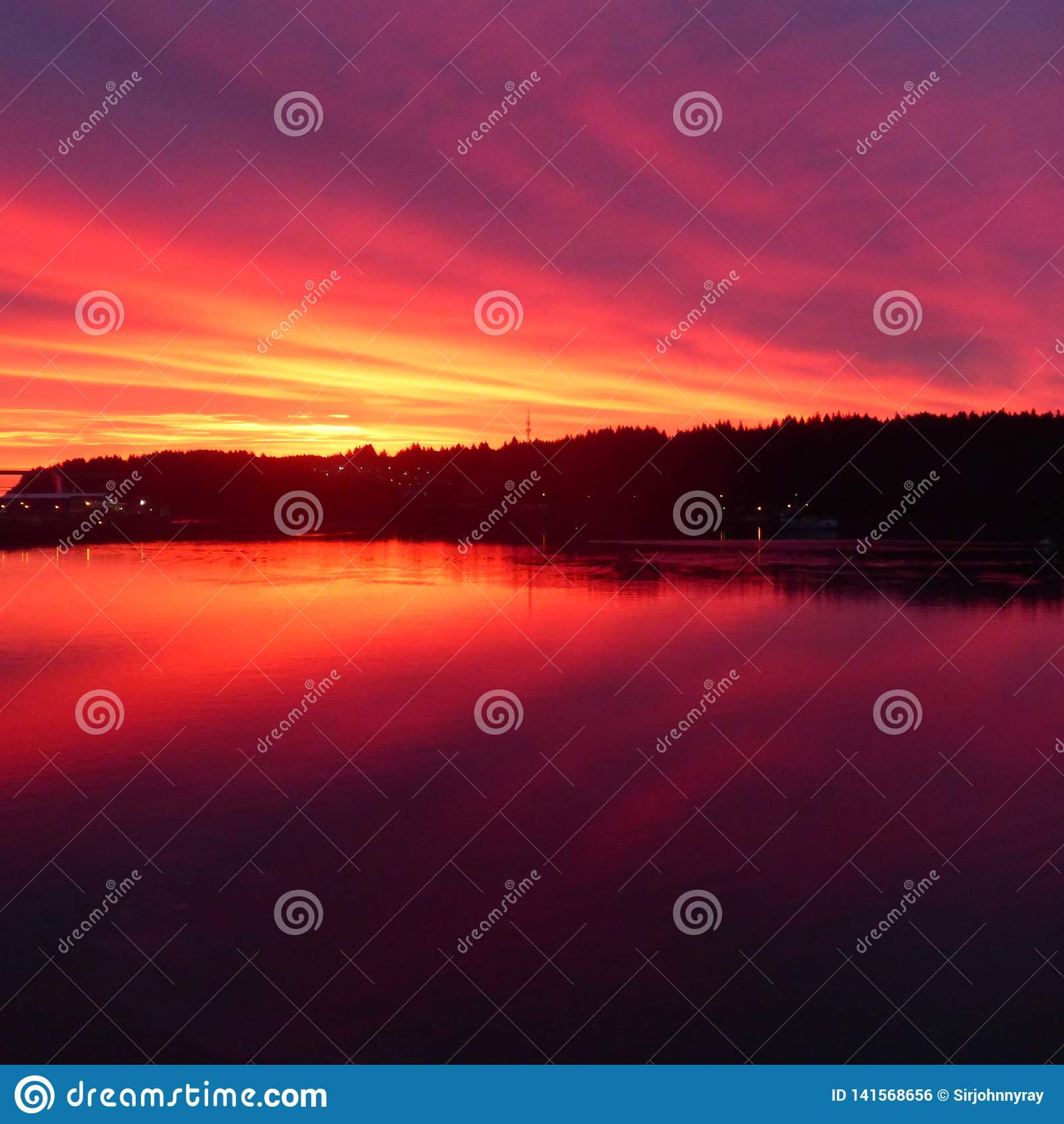 Fiery red and orange sunset over Pacific inlet into the interior of Alaska