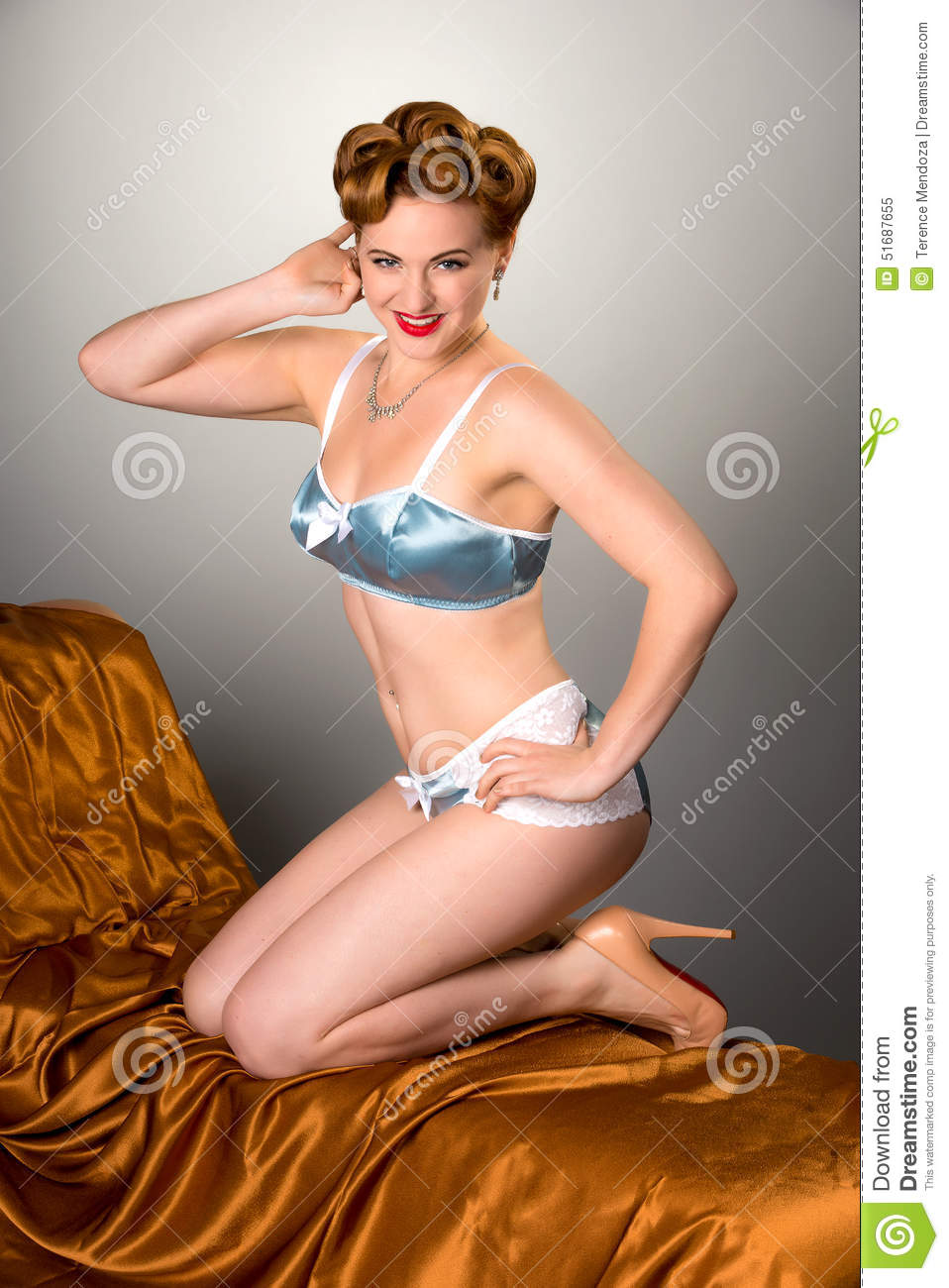 ab8ab404b Fifties Styled Beautiful Redheaded Woman In Satin Lingerie Stock ...