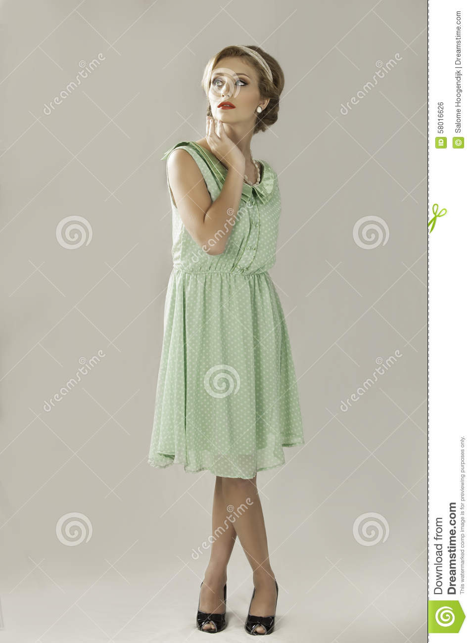Fifties woman in green dress