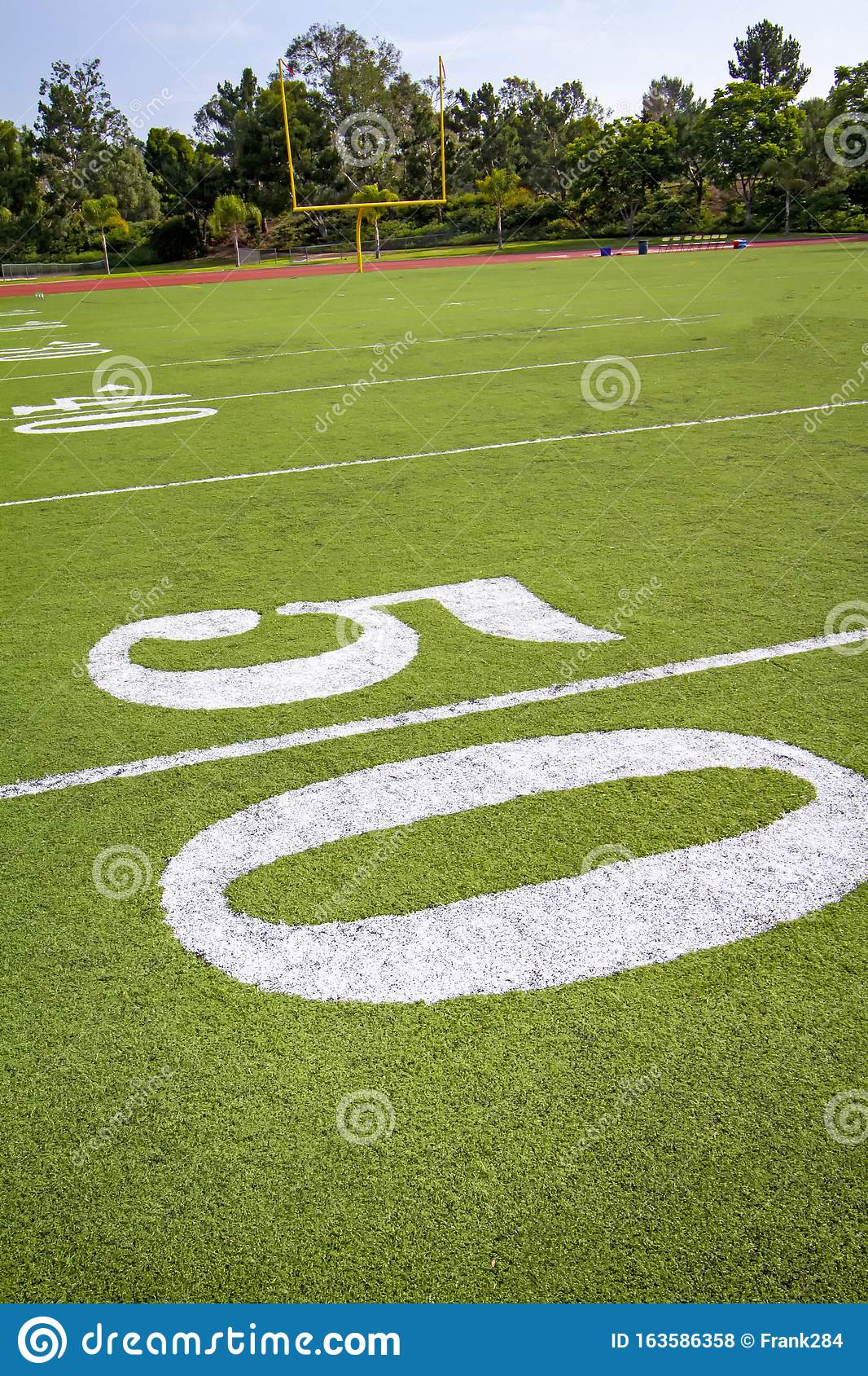Fifty Yard Line On Football Field With Goal Post In ...