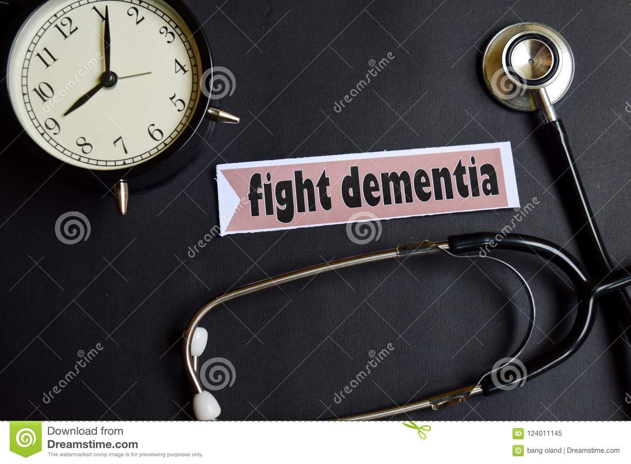 Fight Dementia on the paper with Healthcare Concept Inspiration. alarm clock, Black stethoscope.