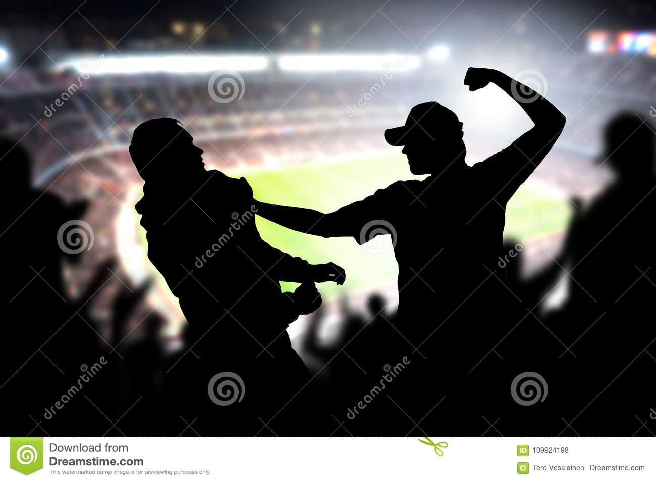Fight in a football game crowd.