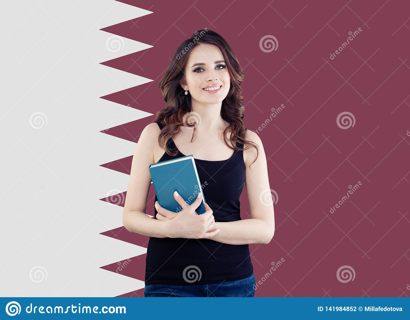Fight for women`s rights and education in Qatar. Happy woman student against the Qatar flag background