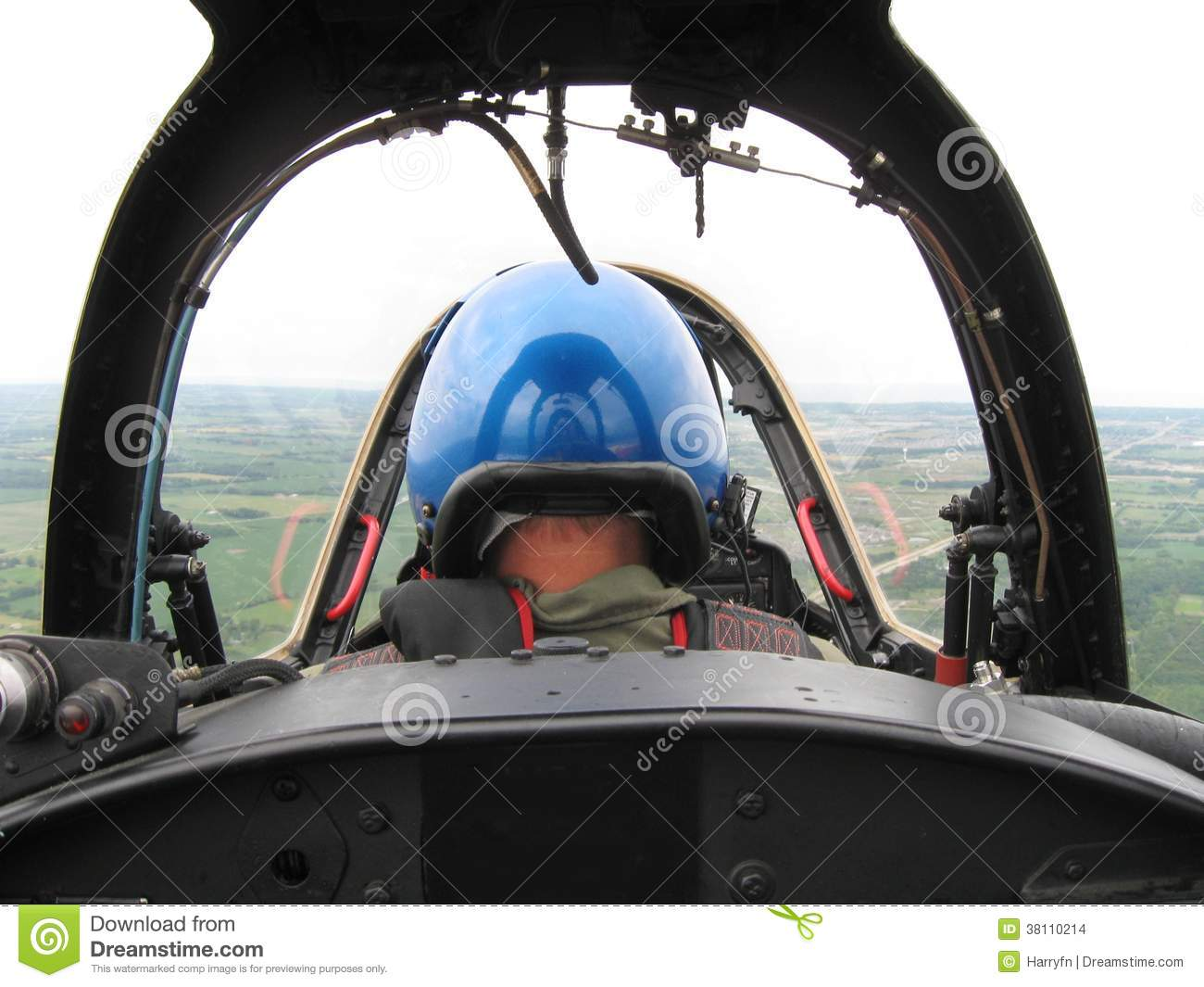 Fighter pilot flying his fighter in low altitude.