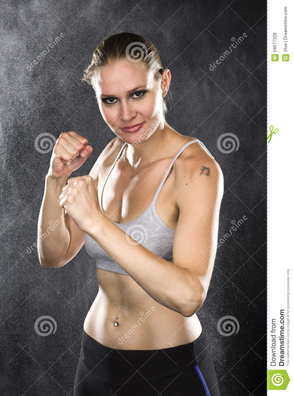 Fighter Woman Smiles at Camera Against Water Drops