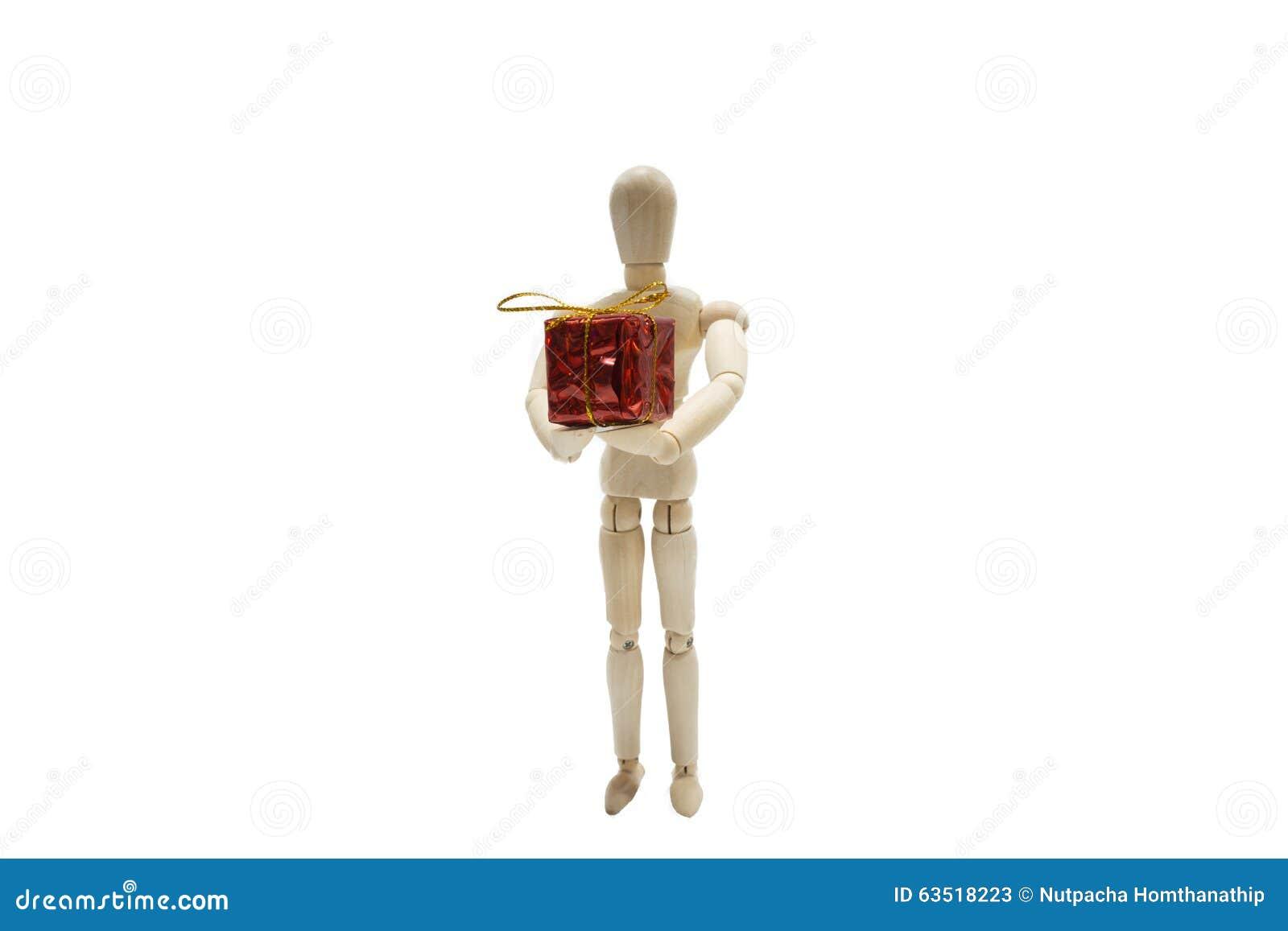 Foto de Stock: Figura de madeira boneca e caixa de presente vermelha  #85A724 1300x957