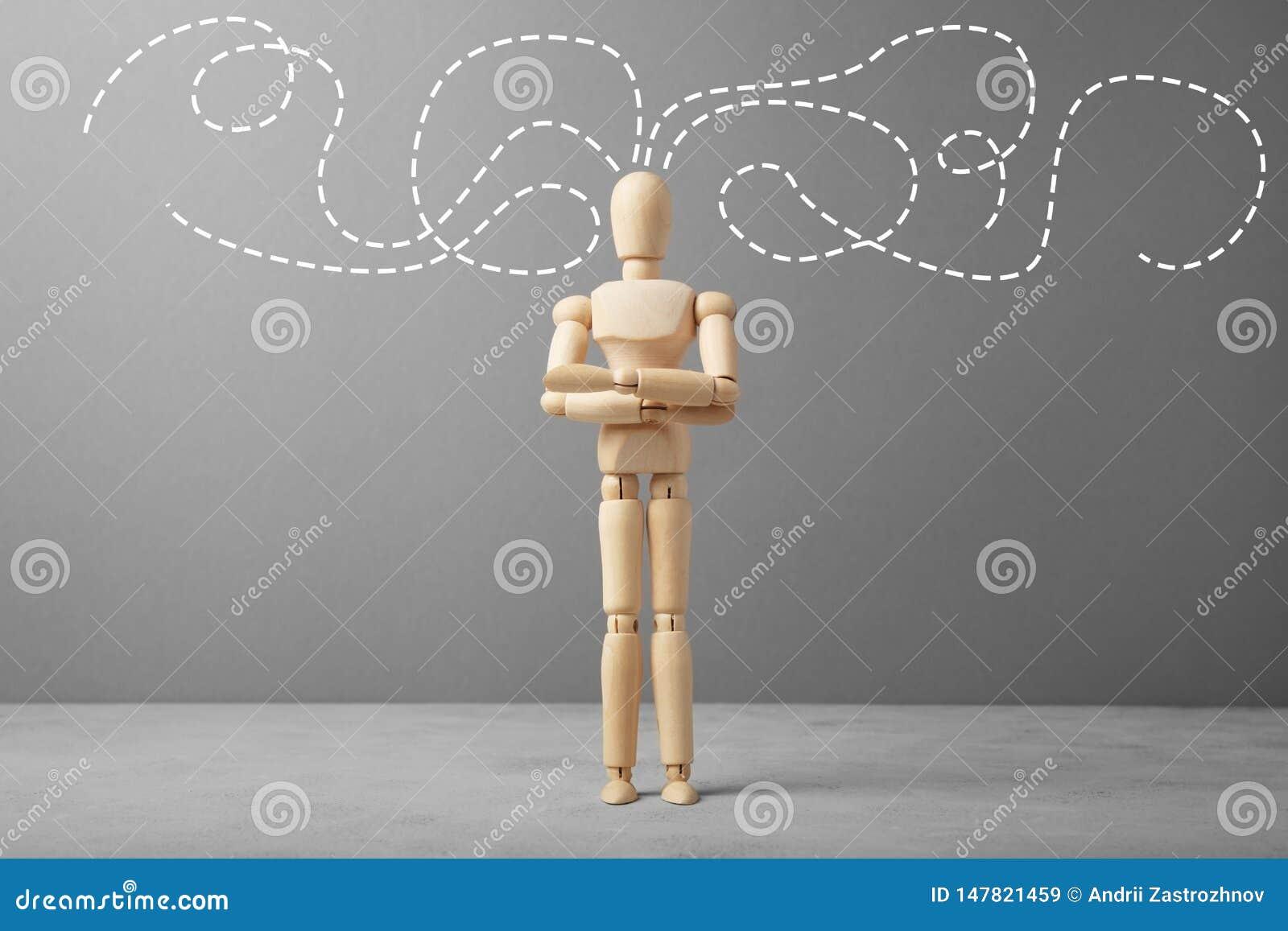 Figure en bois d homme d affaires avec des pensées au sujet des affaires