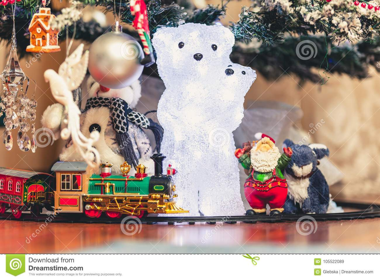 Figure Of Polar Bear With Bear Cub Under Christmas Tree Stock Image
