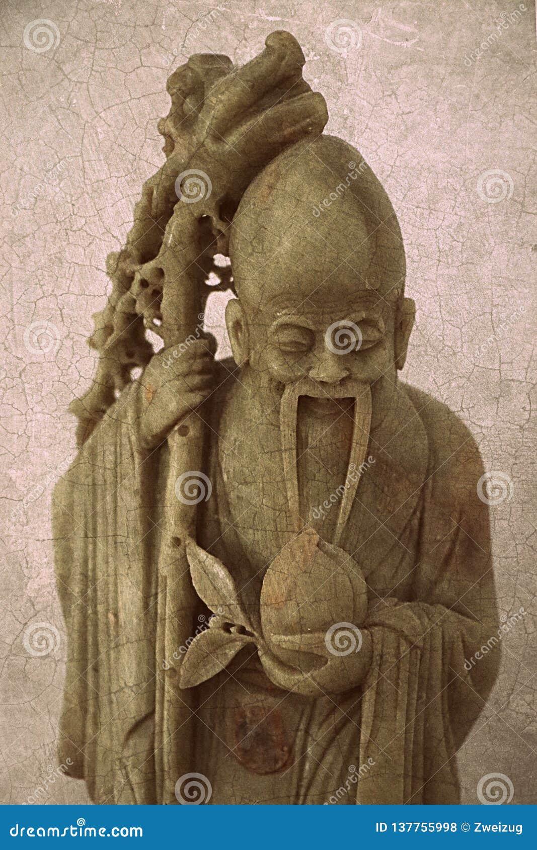 Figurilla antigua del monje de la esteatita del vintage que talla el fondo abstracto de la textura de la superficie del modelo de