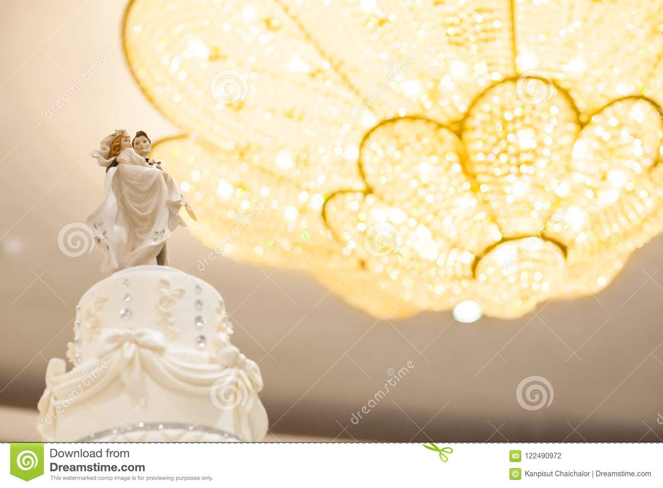 Figurines Of The Bride And Groom On A Wedding Cake. Stock Photo ...