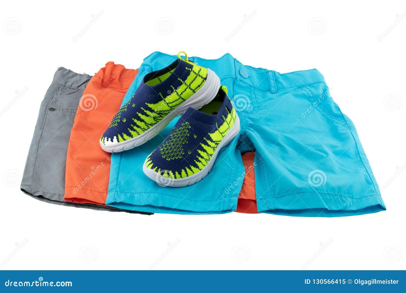 Fije de la moda del verano para los muchachos Un sistema de tres pantalones cortos coloridos f