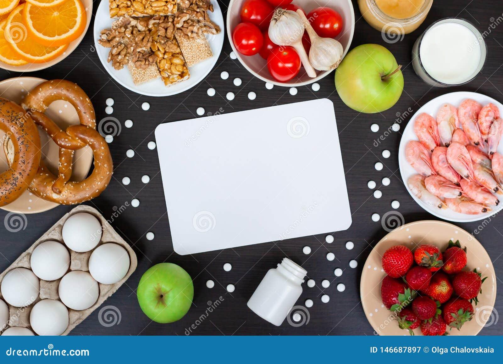 Fije de los productos alérgicos como leche, naranjas, tomates, ajo, camarón, cacahuetes, huevos, manzanas, pan, fresas