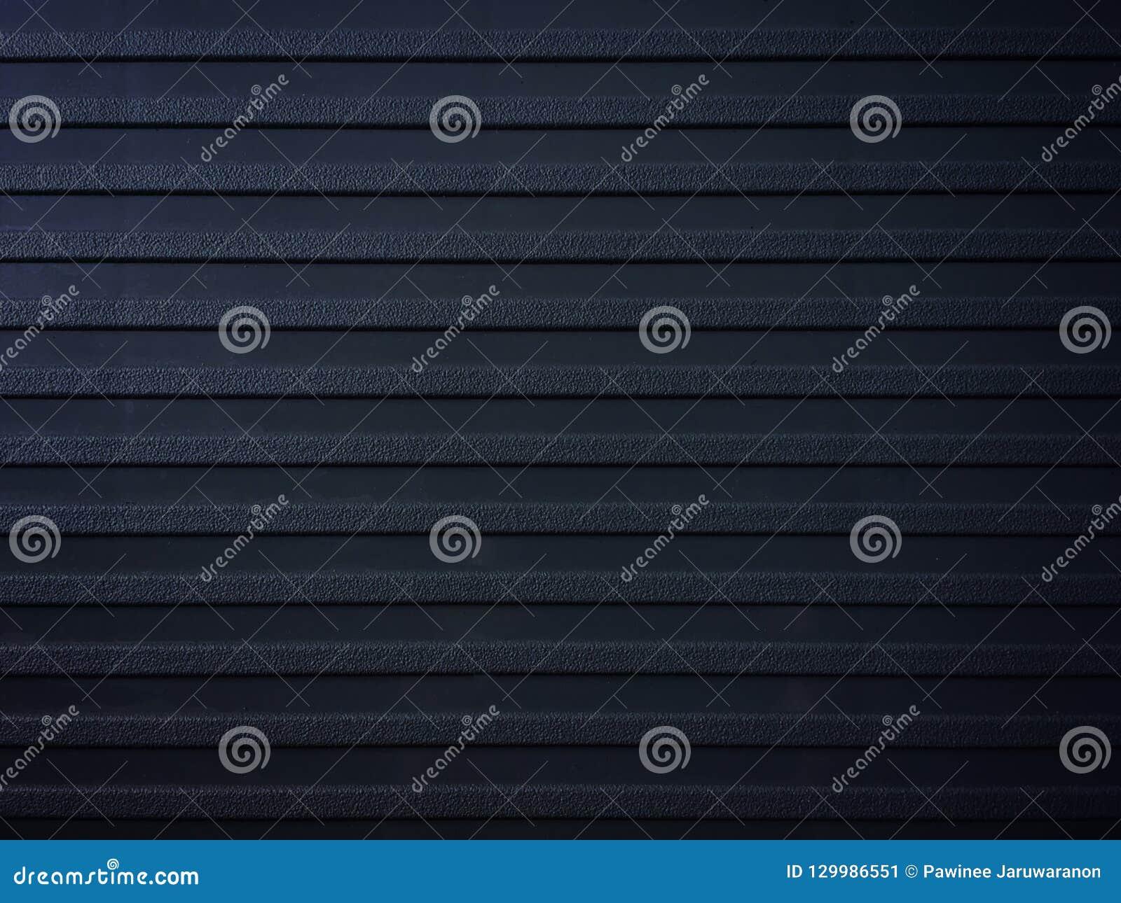 Fila de la superficie áspera en el fondo negro de la decoración del asiento