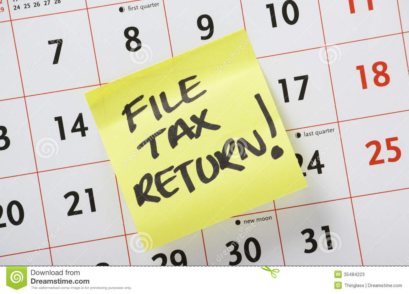 ... Tax Return on a yellow post it note stuck to a calendar background
