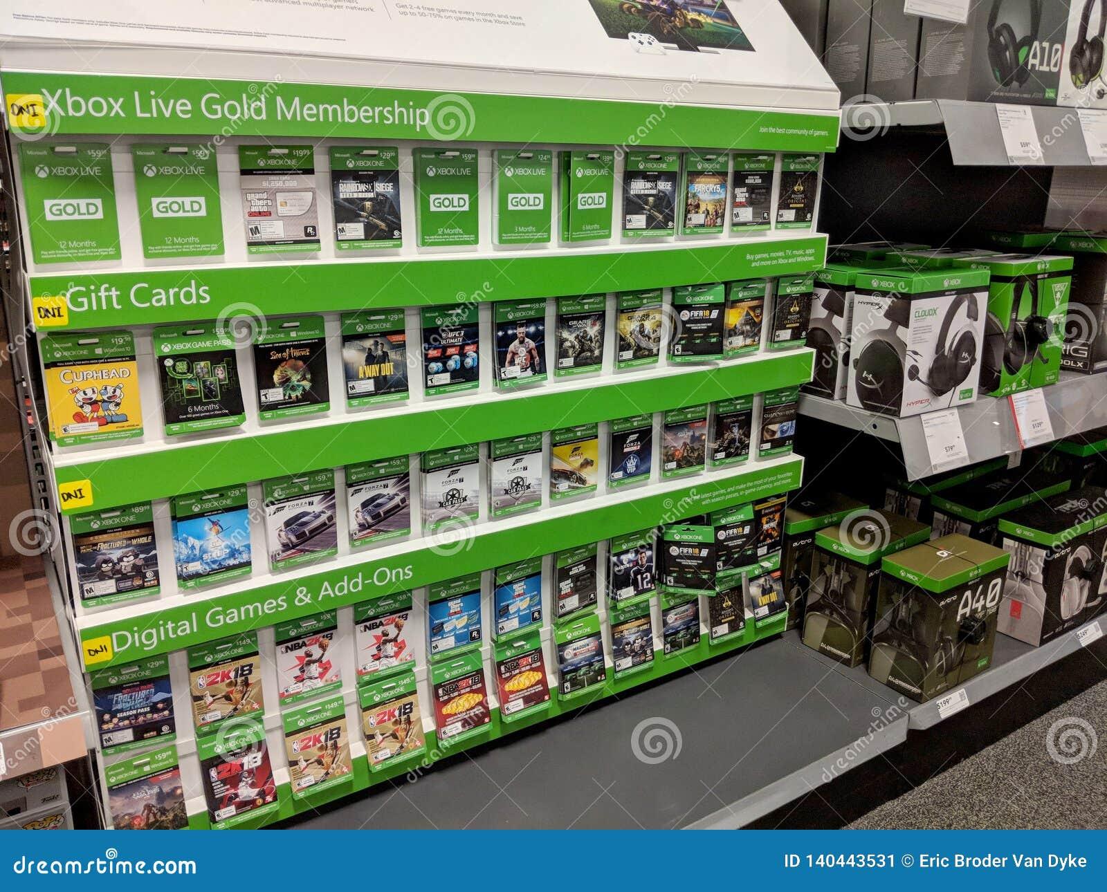 Fileiras de jogos do Xbox One na exposição dentro da loja de Best Buy