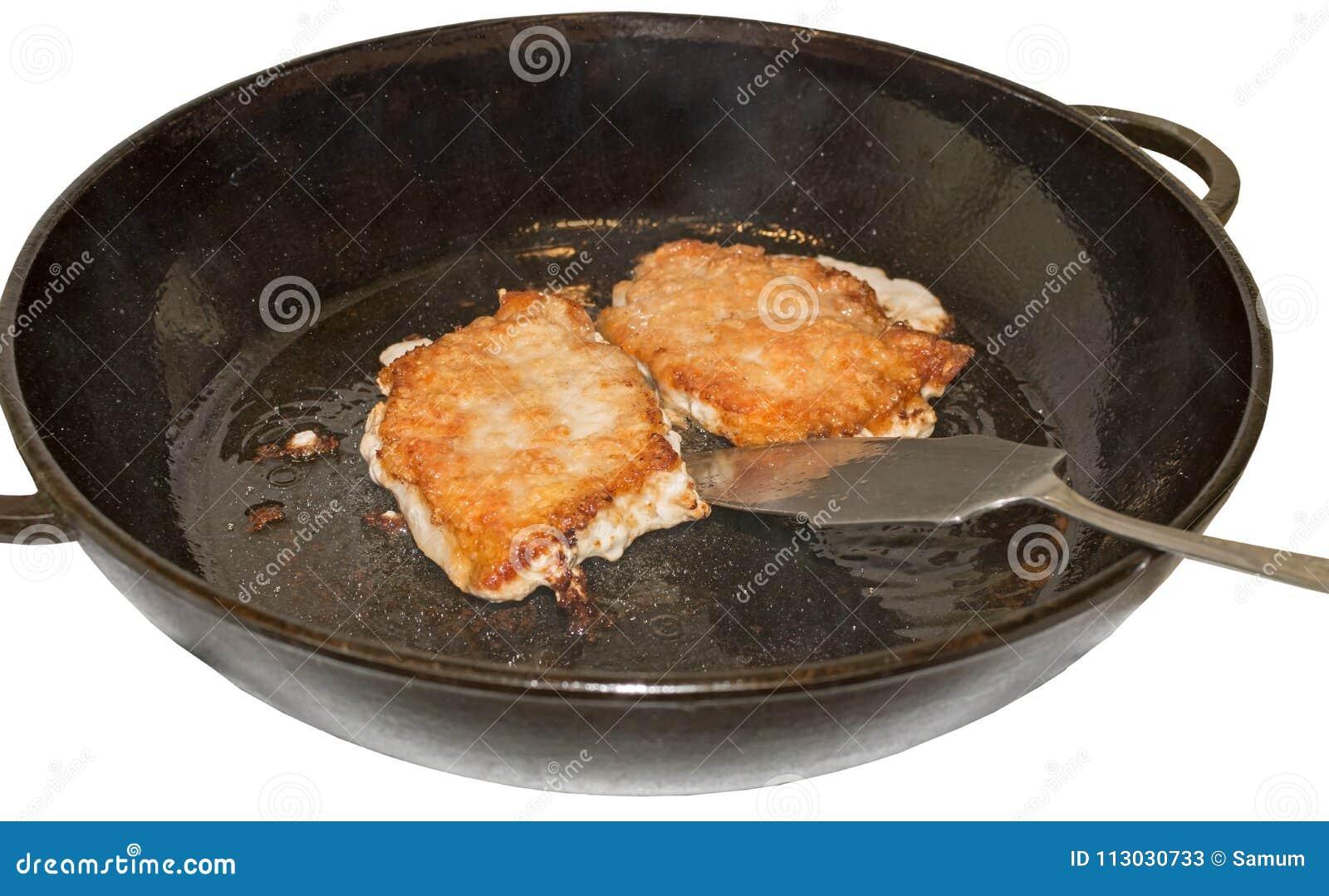 Filete jugoso gordo del cerdo dos en el aceite de oliva en un sartén