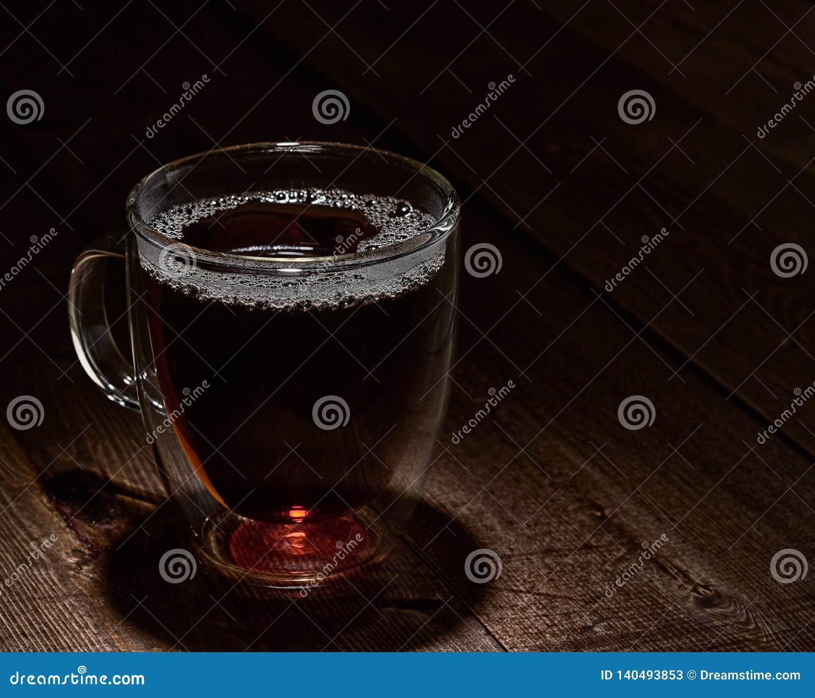 Filiżanka herbata w Markotnym oświetleniu