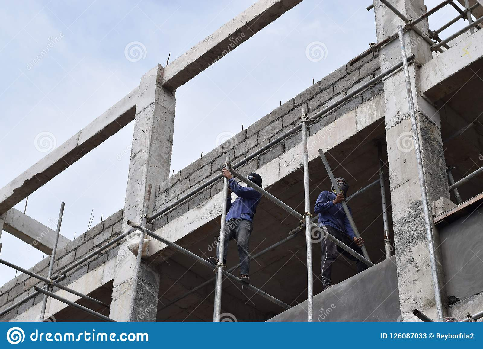 Filipino Construction Workers Installing Metal Pipe