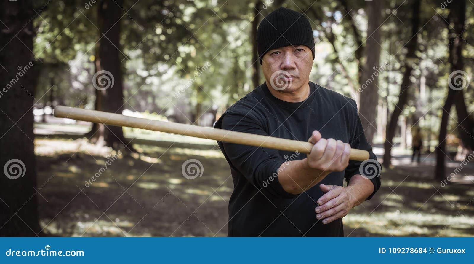 Filipino Martial Arts Instructor Demonstrates Stick Fighting