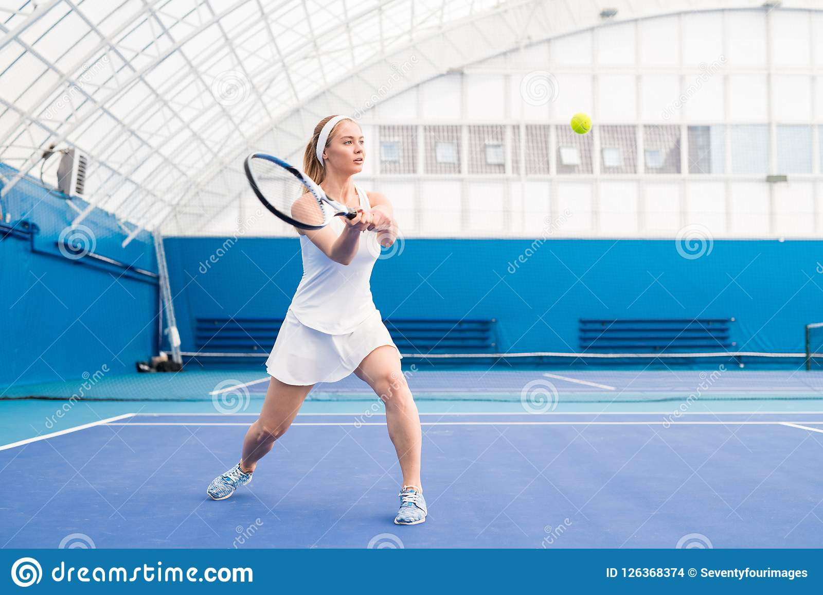 Blonde Young Woman Playing Tennis