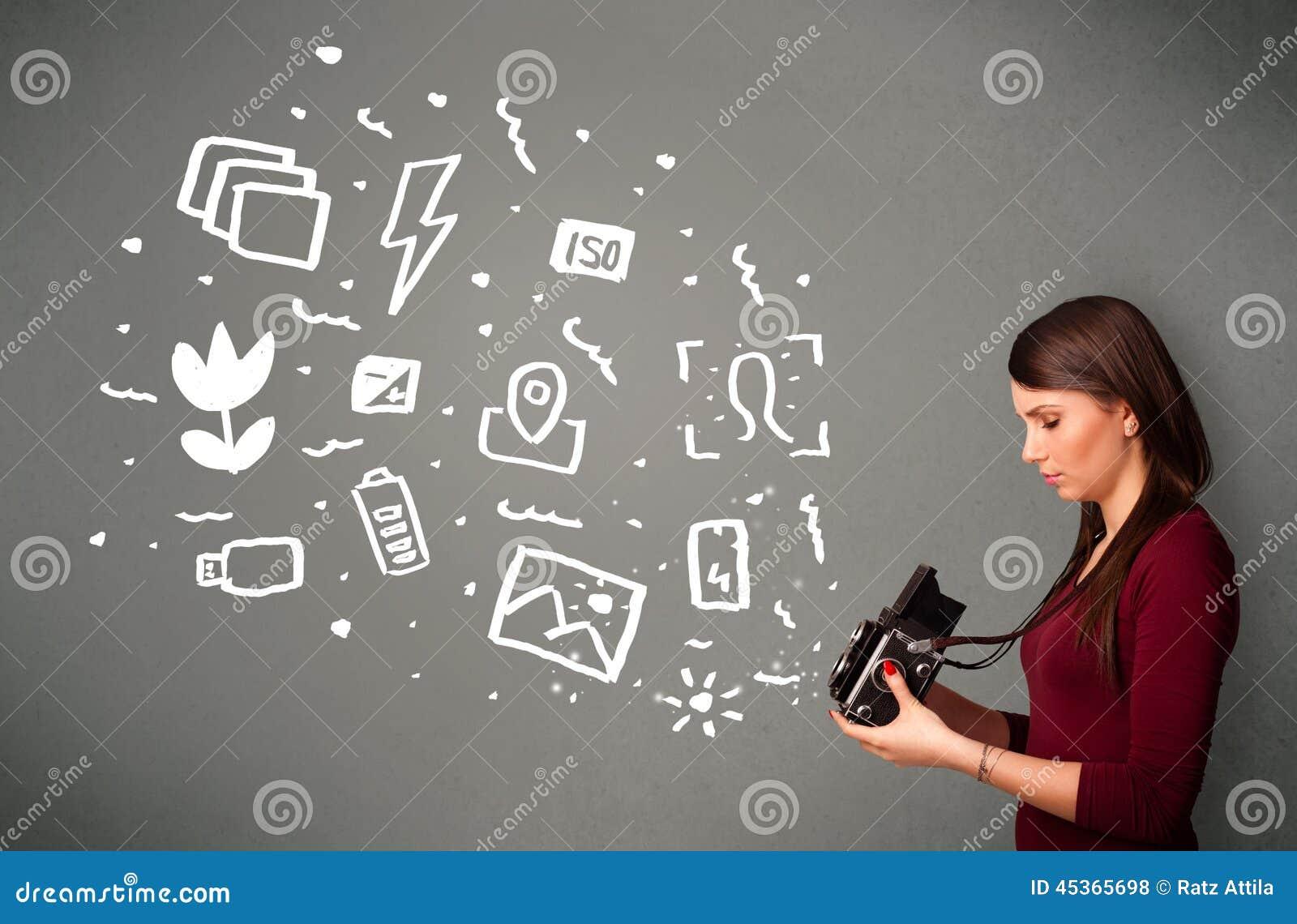 Fille de photographe capturant les icônes et les symboles blancs de photographie