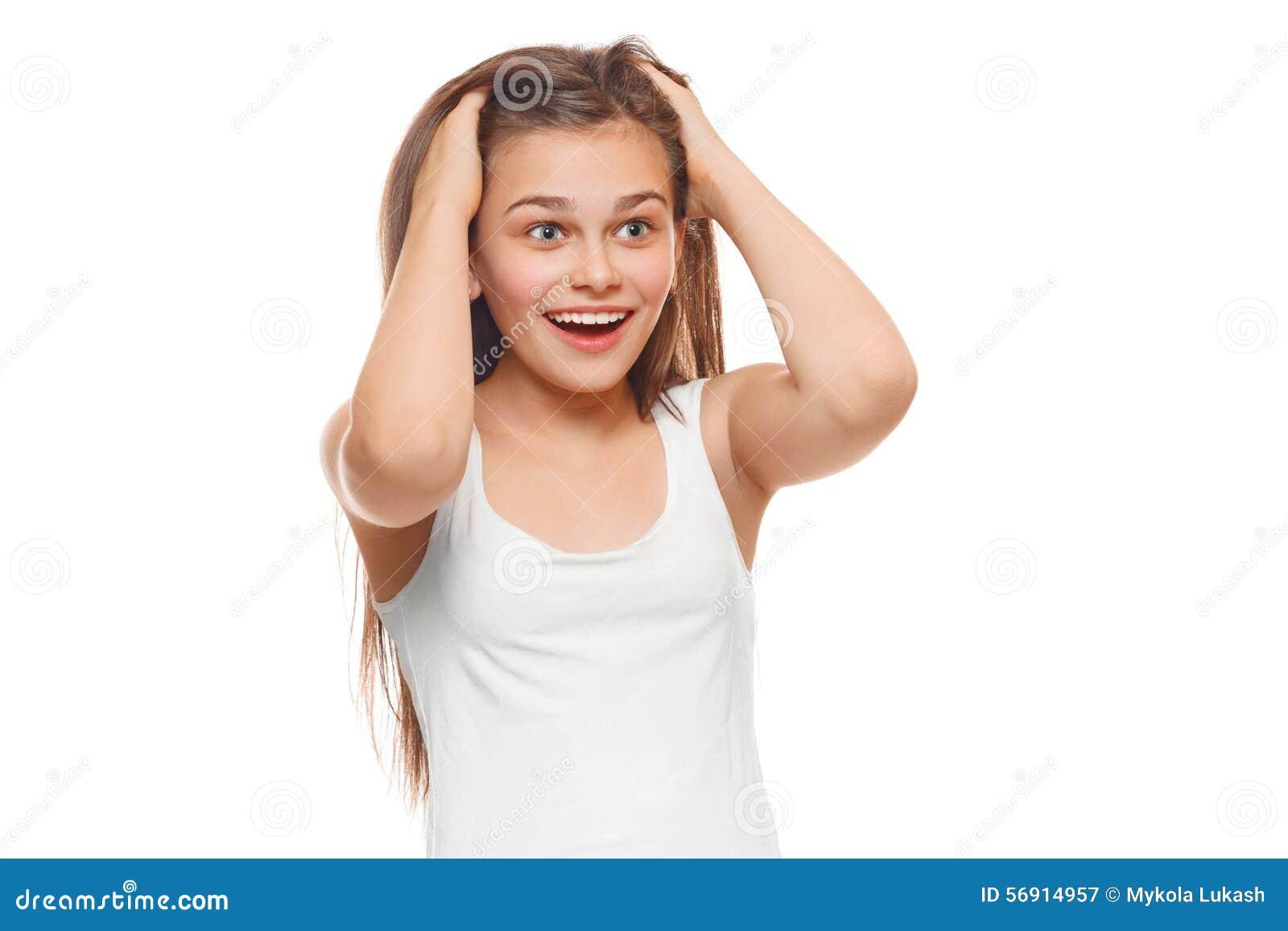 Fille heureuse étonnée d adolescent regardant pour dégrossir dans l excitation D isolement au-dessus du fond blanc