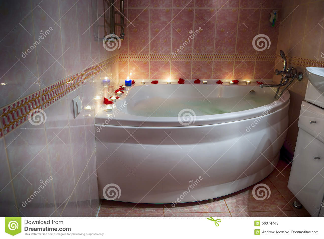 Filled With Foam Bath Rose Petals And Candles Stock Photo Image - Candles for bathroom